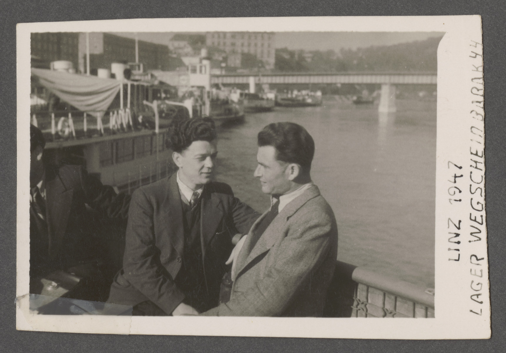 Close-up portrait of Joseph Pinczuk and his brother-in-law Julius Yarchin in postwar Linz.