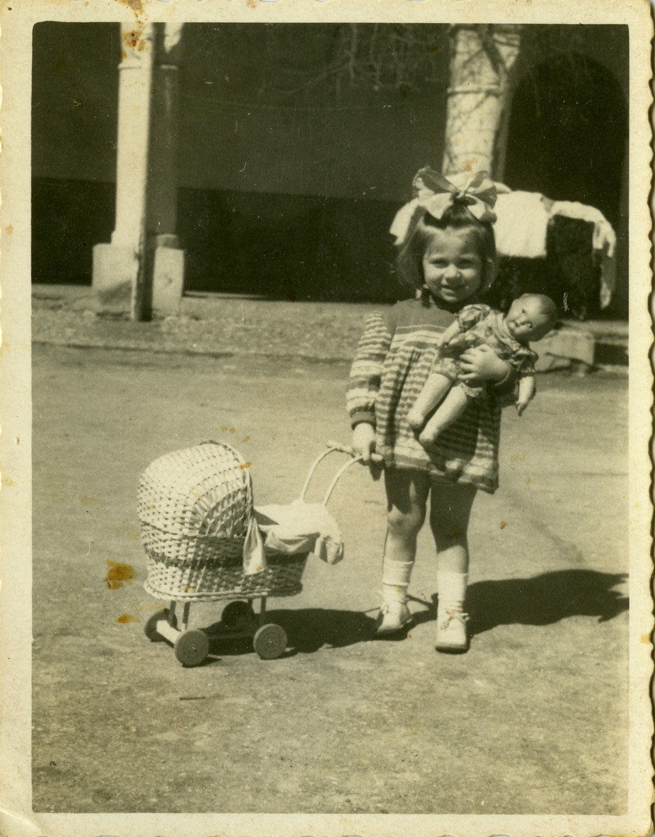 Shulamit Kagan holds her doll in the Cremona displaced persons camp.