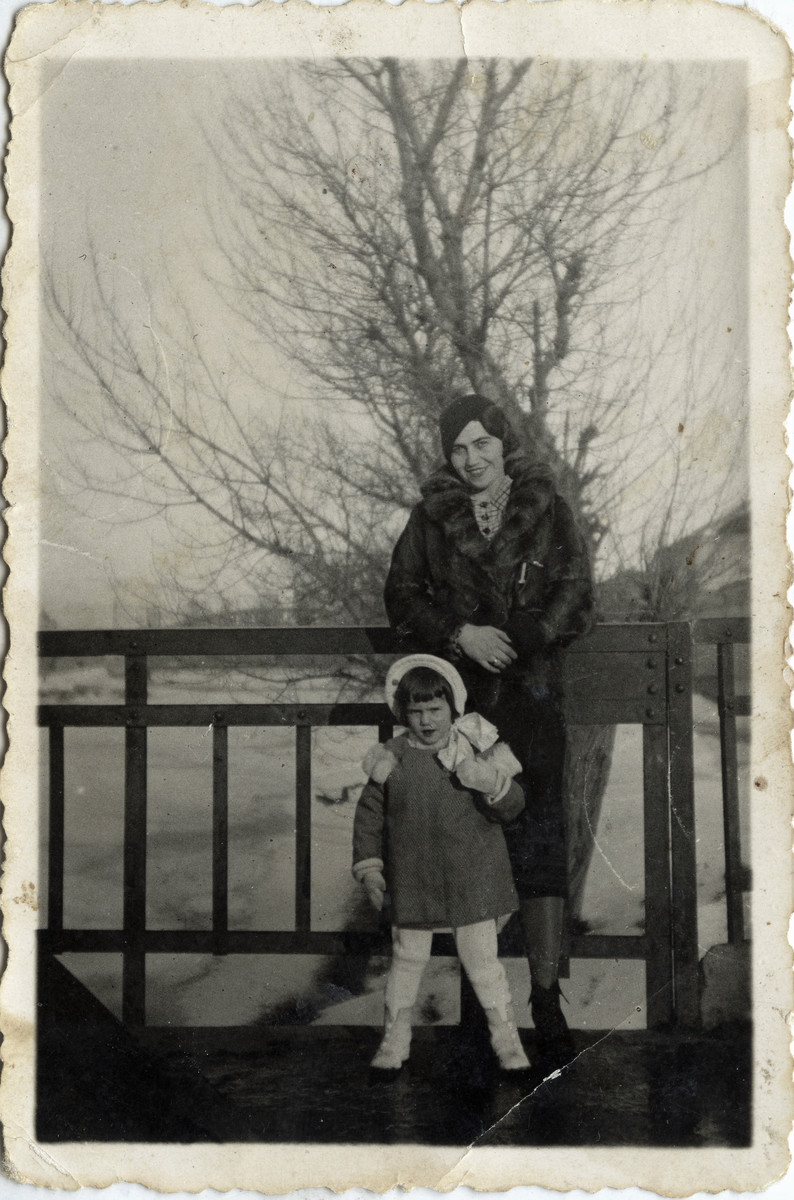 Izak Manojlvic's sister Sophia stands with her daughter Marika by a frozen river.  Both perished during the Holocaust.