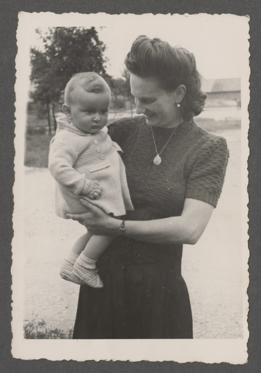 Fania Pinczuk holds her infant son Aaron Jonah in the Wegscheid displaced persons camp in Linz, Austria.