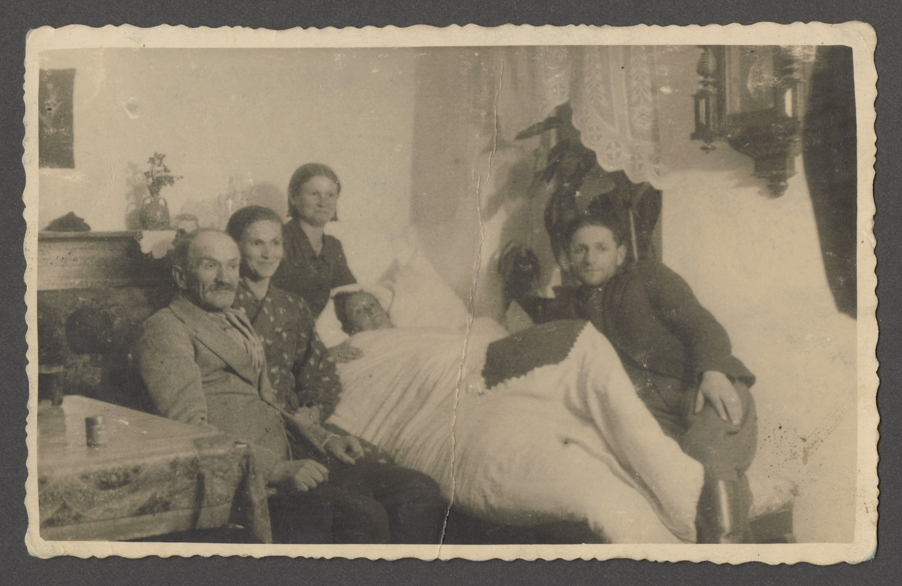 The Scwarczman family gathers around Leah Scwarczman shortly before her death.  Pictured from left to right are Joseph, Sophie, Sonia and Bennick Goldshein (Sophie's husband).