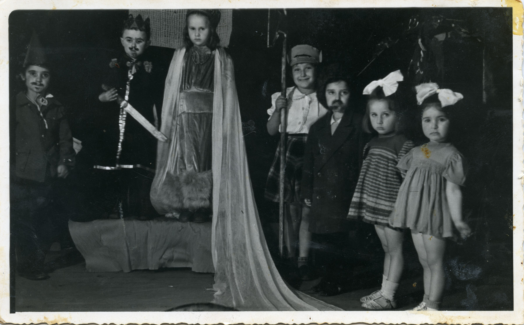 Jewish children participating in a Purm party.  Shulamit Kagan Gilor, second from right, performing with other children in the Displaced Persons Camp in Cremona.