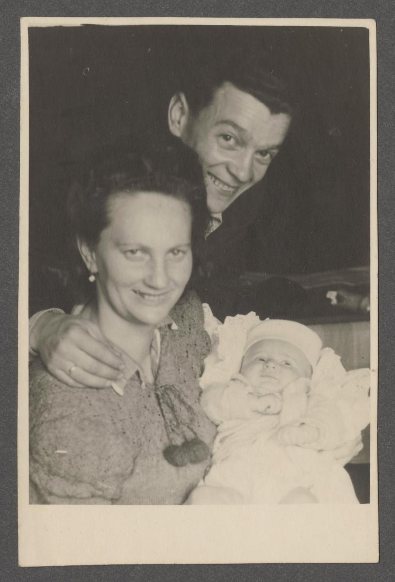 Joseph and Fania Pinczuk hold their newborn son Aaron Jonah in the Wegscheid displaced persons camp in Linz, Austria.