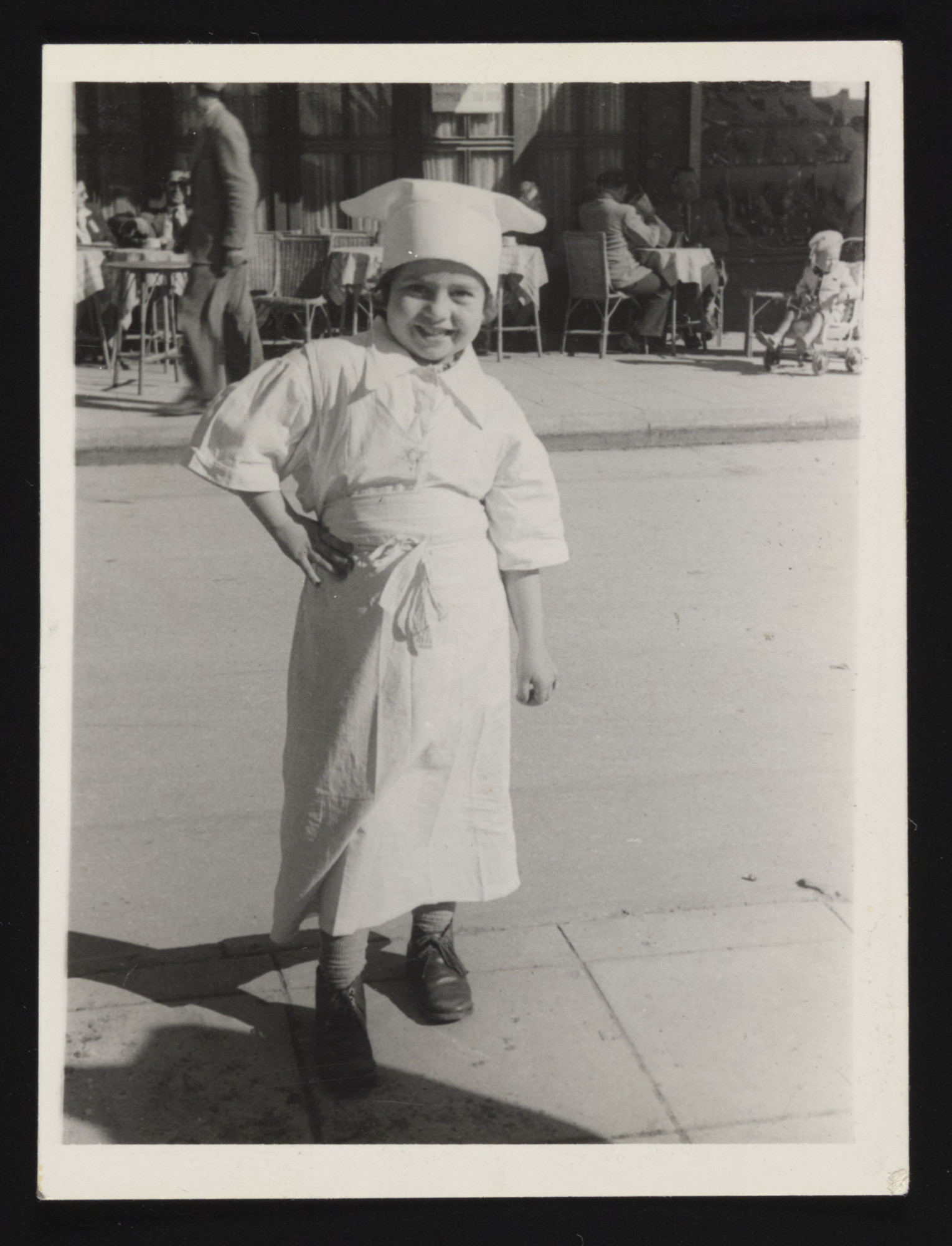 Edna Weissman (Tamar's cousin) poses on the street  in Yugoslavia wearing a chef's costume.