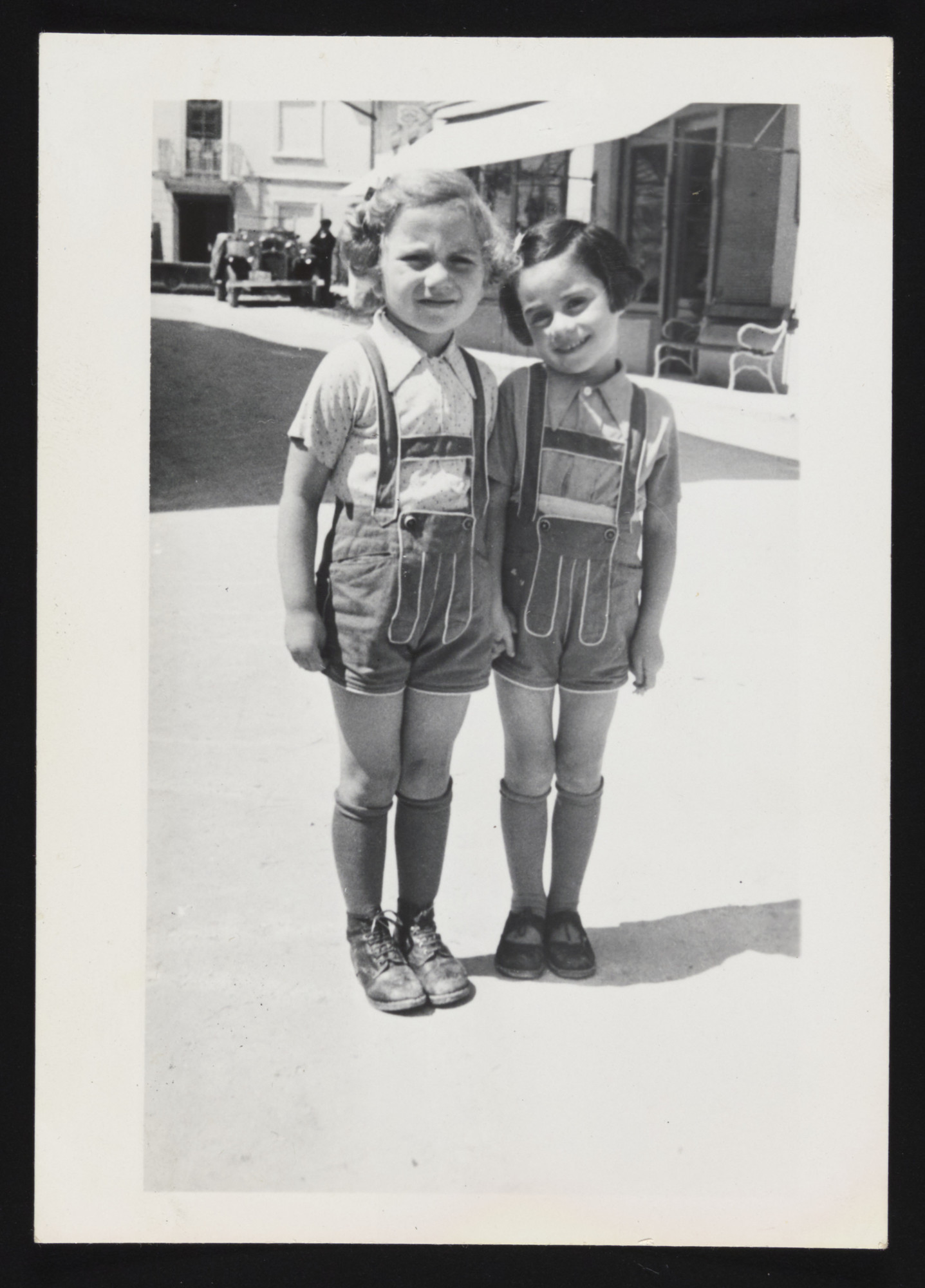 Tamar Hendel and her cousin Gisele Kremer pose on a street in prewar Croatia.