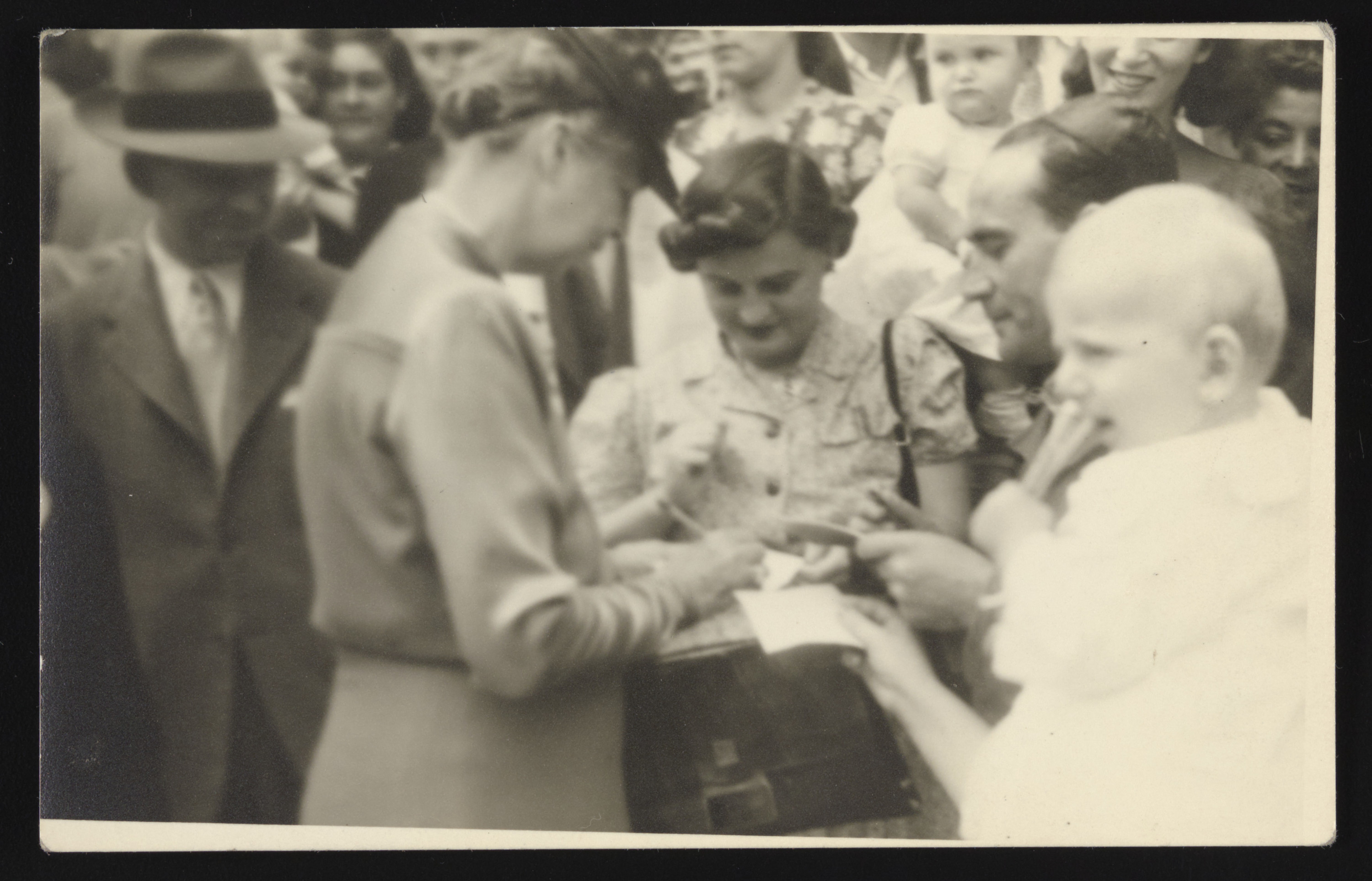 Eleanor Roosevelt visits Fort Ontario Emergency Refugee Shelter in Oswego, NY, where the Hendels were relocated upon arrival to U.S.   Eisik Hendel is standing on the right.