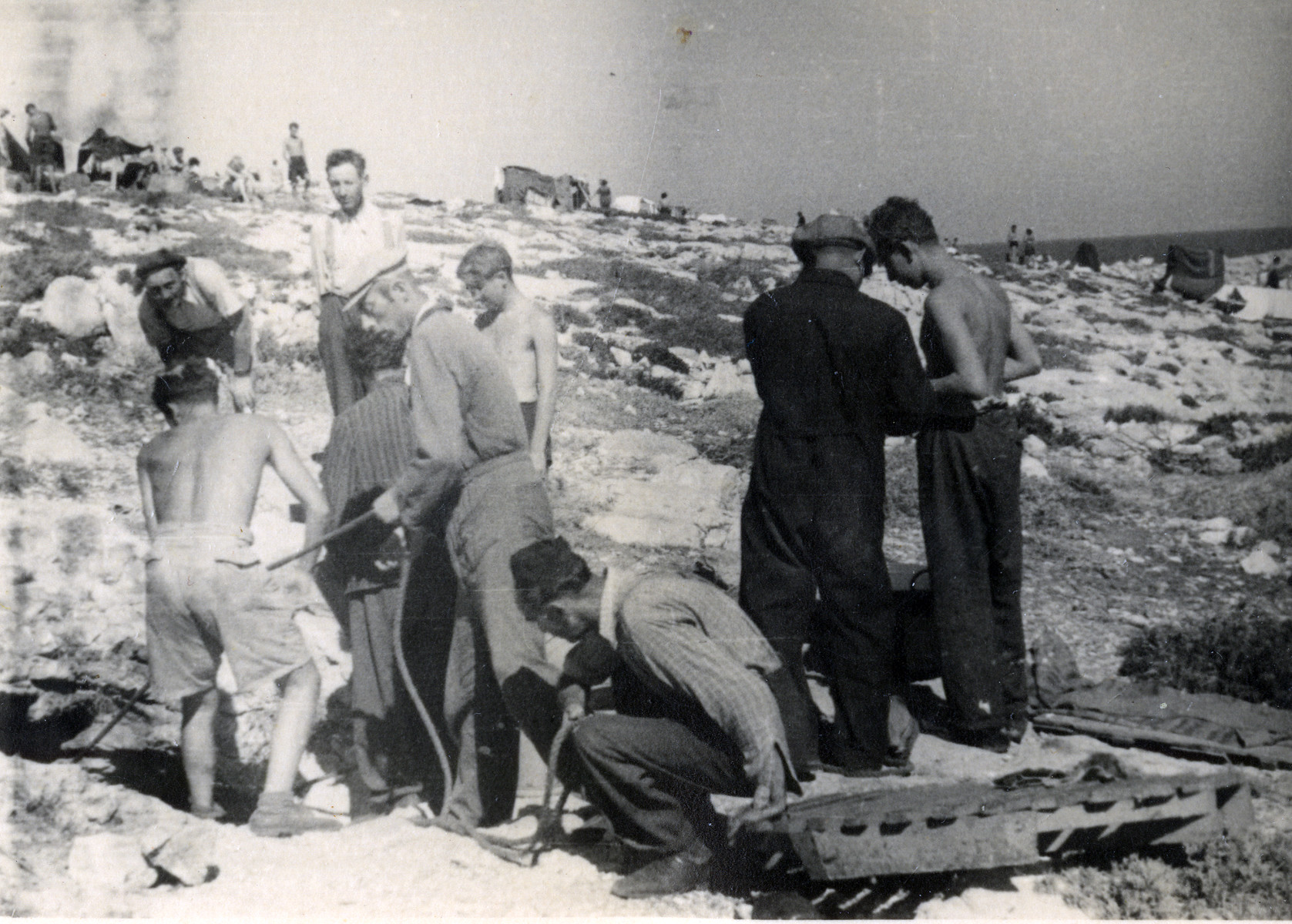 Survivors of the shipwrecked Pentcho dig on the island of Kamilonissi.