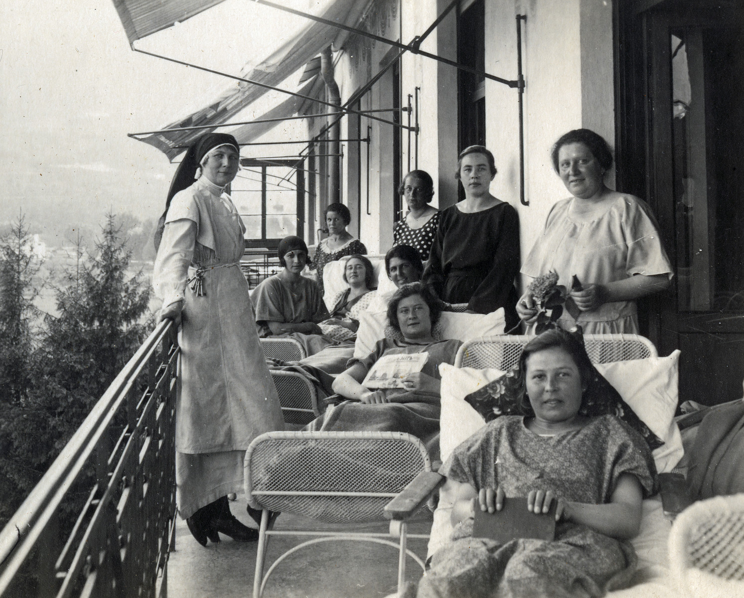 Female patients rest on the terrace of a sanatorium in Merano, Italy