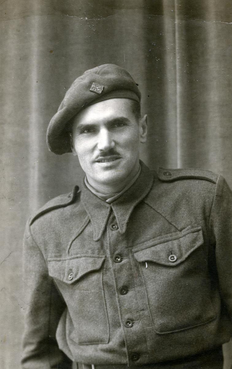 Portrait of a Jewish Brigade soldier in uniform.  Probably Ernest Hellinger.