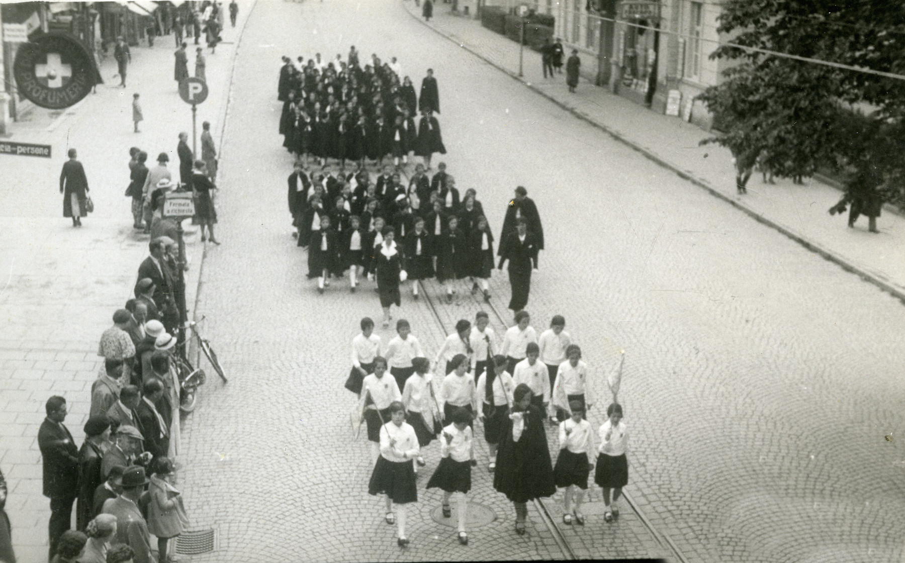 Members of the Fascist Youth movement Picolo Italiana march down a street in Merano in honor of Mussolini.  Among those pictured is Anna Kohn (membership in the organization was obligatory at that time; even for Jews).