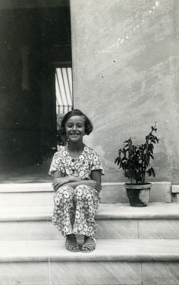 Anna Kohn poses on the steps of her house in Milan.
