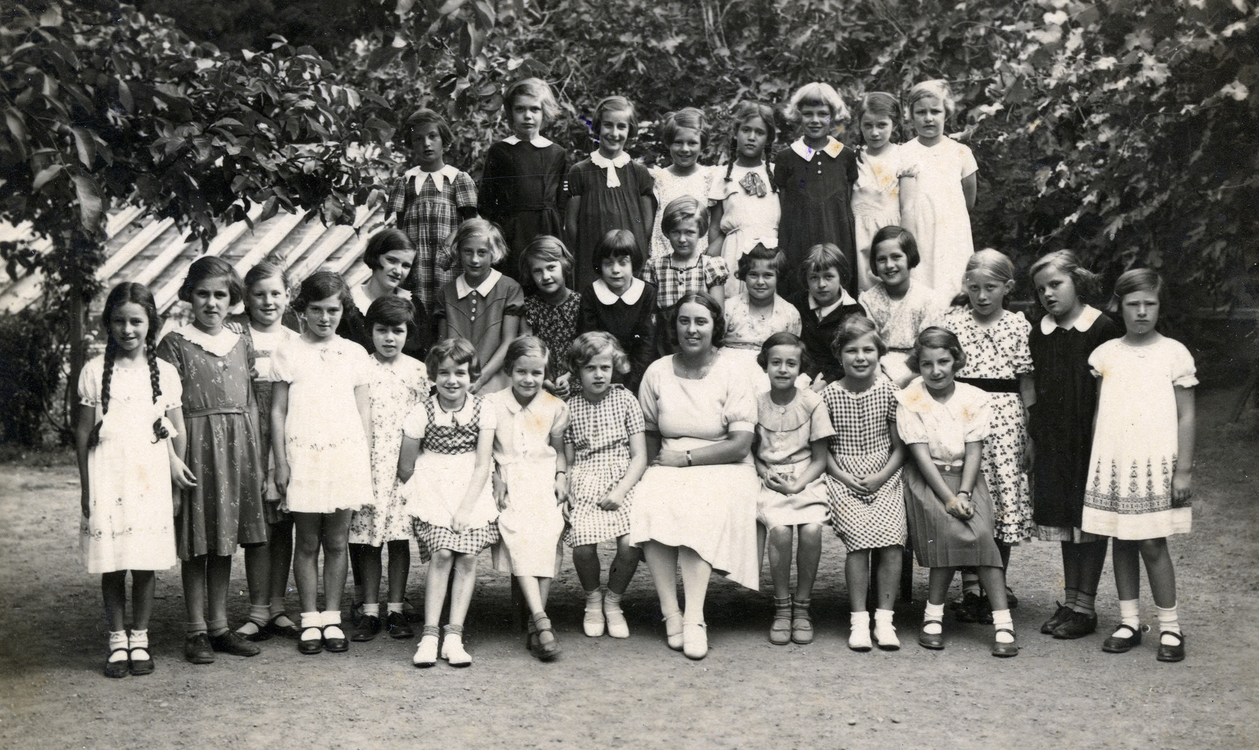 Class portrait of a school in Merano Italy.  Anna Kohn is pictured sitting third from the right.