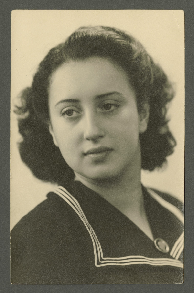 Studio portrait of Elly Rodrigues taken after the war and inscribed to her loving brother.