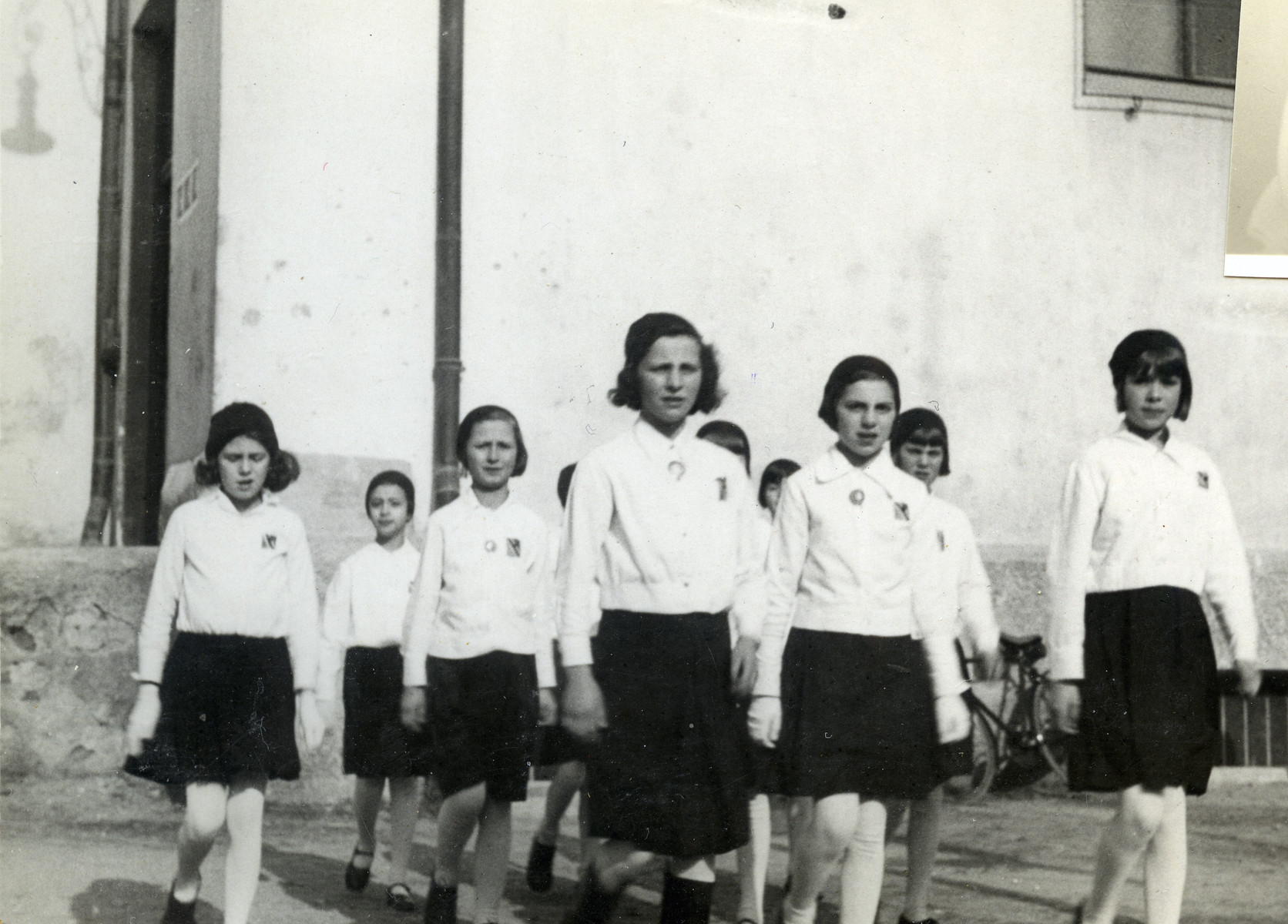 Group portrait of young girls belonging to the Fascist youth movement Picolo Italiana rallying for Mussolini.   Among those pictured is Anna Kohn. Membership in the organization was obligatory at that time, even for Jews.