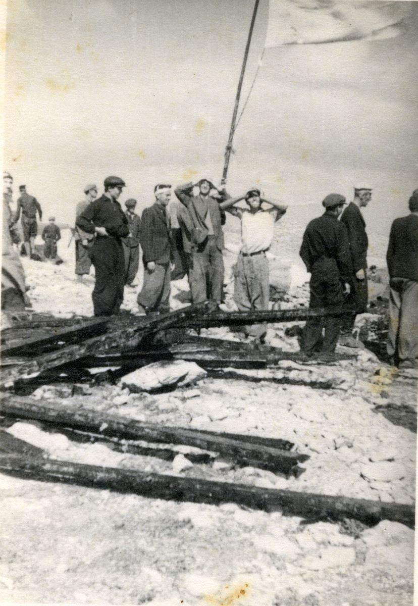 Survivors from the shipwrecked Pentcho await help on the island of Kamilonissi.