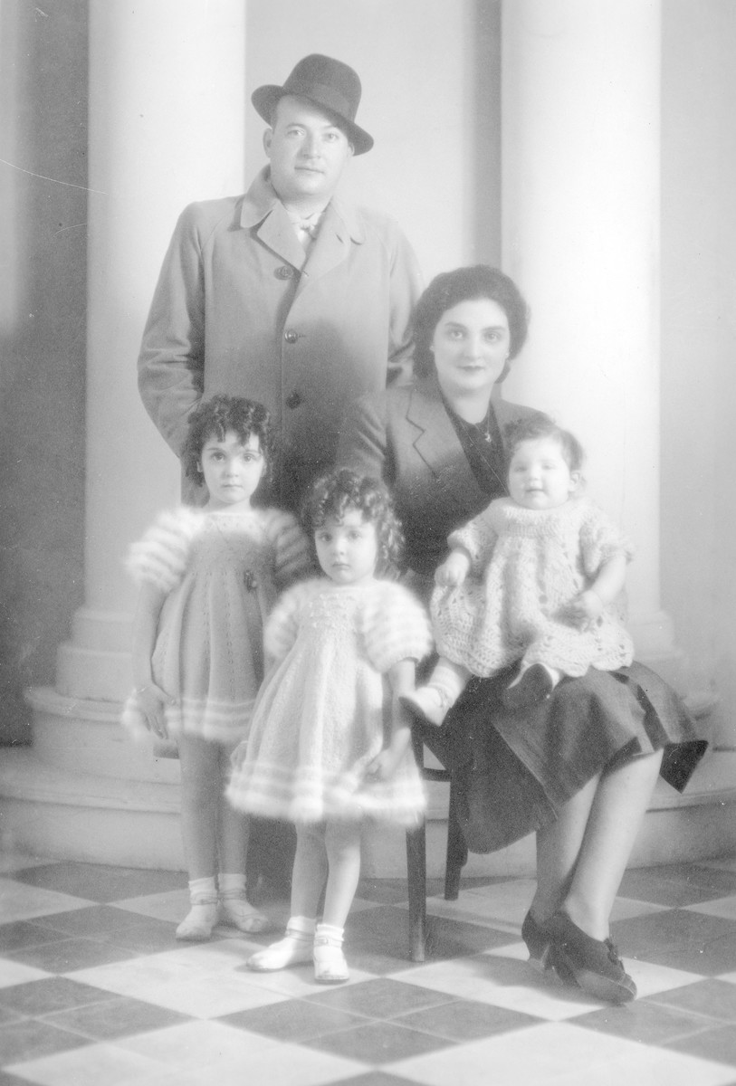 Studio portrait of Perla and Felix Nahmani with their three oldest daughters Diamante, Aimee and Reine.