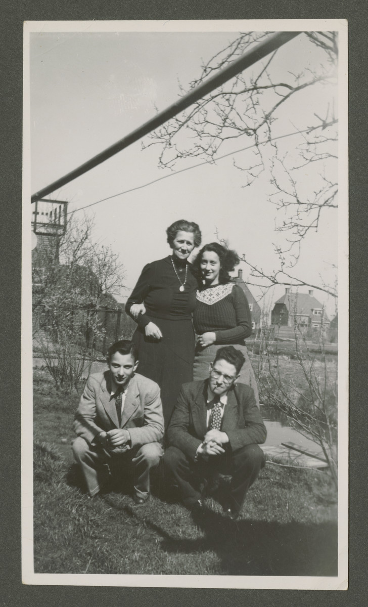 Elly Rodrigues poses with her rescuer/foster mother Grietje Bogaards after the war.  Also pictured are her brother Henri (bottom left) and another young man.