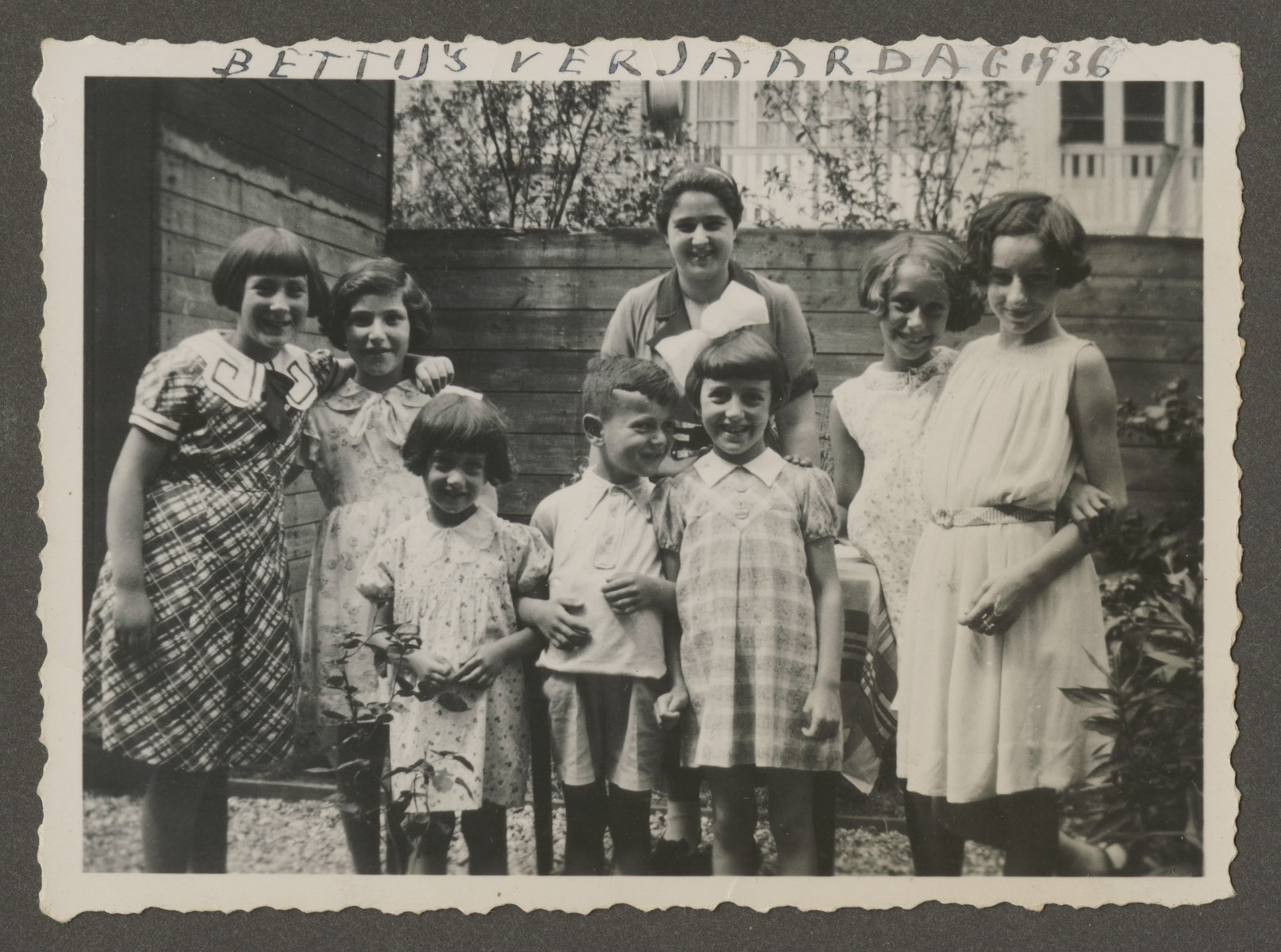 Elly and Henri Rodrigues (front, center) attend a birthday party in prewar Amsterdam.    Lynne Coopman (the cousin of Leah) is standing in the back center.