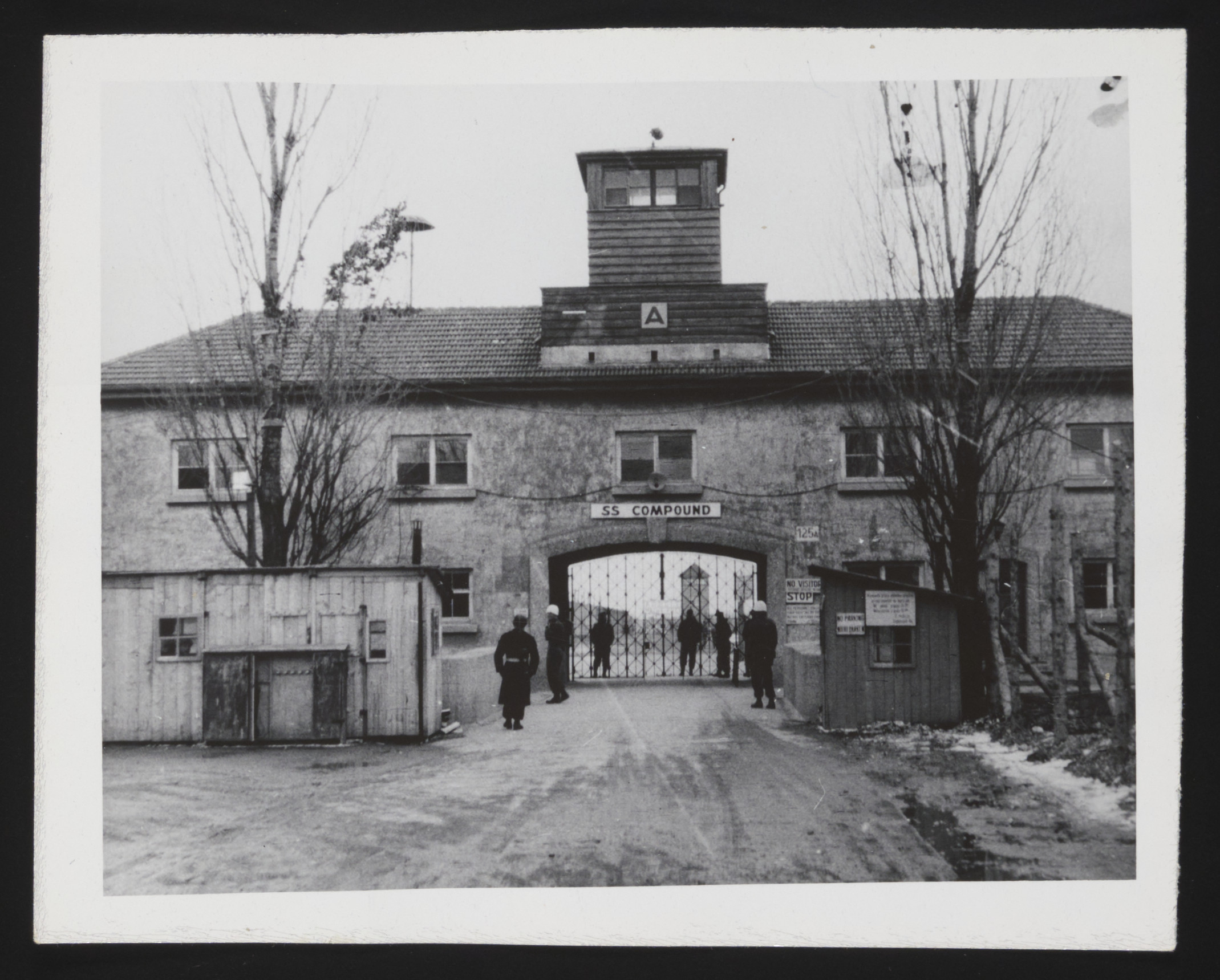 American troops guard a prison for former SS troops on the site of the Dachau concentration camp.
