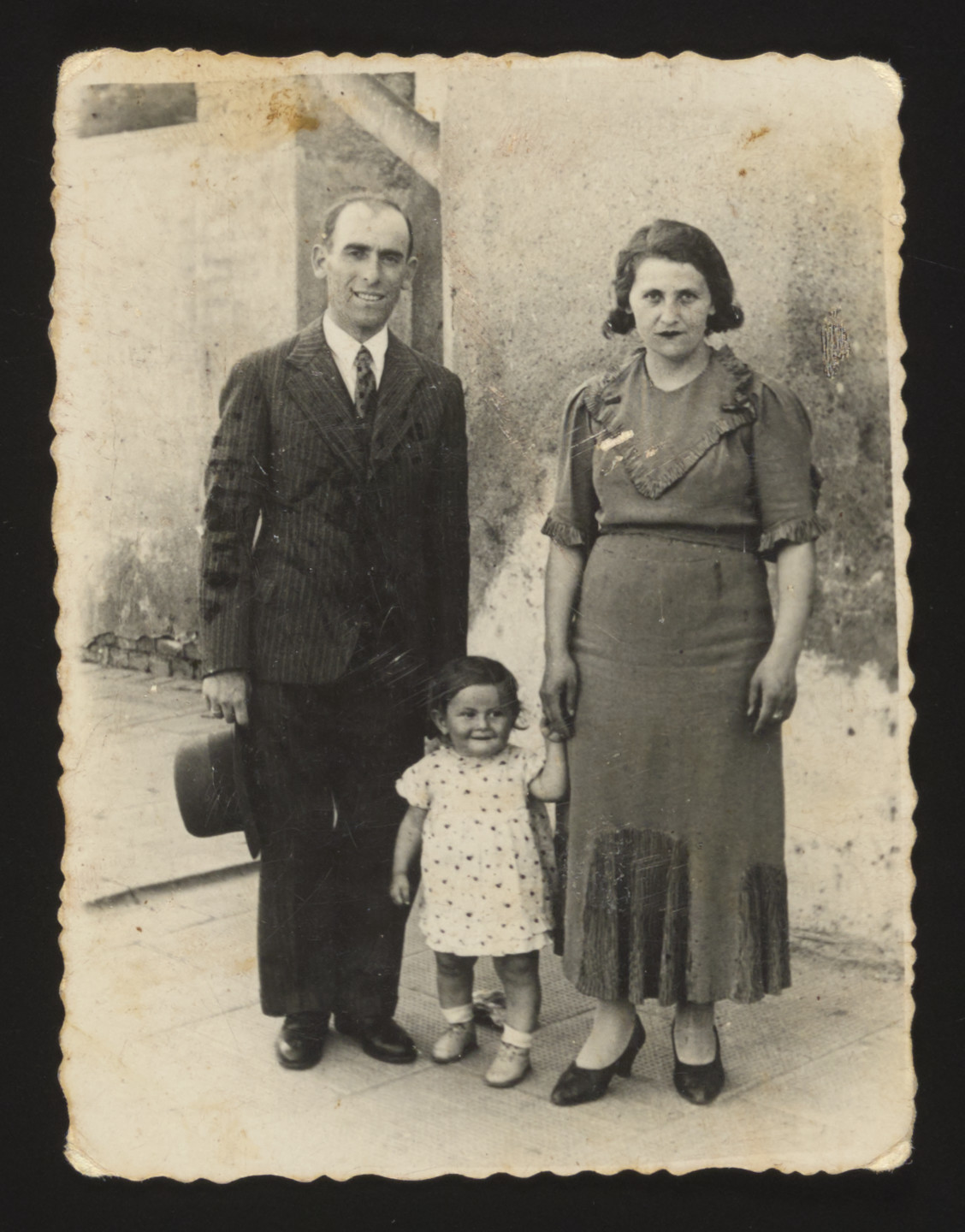 A Jewish family from Kozienice stands outside a building.  Pictured are Mordechai, Genia and Chaja Rubinsztajn.  The entire family perished in Treblinka.