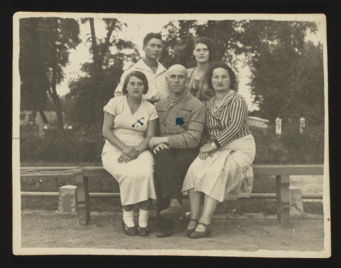 Members of the extended Szabason family pose on a bench in a park in Kozienice.  Pictued standing from left to right are: Aaron and Etel (Szabason) Erlichman. Seated from left to right are: Chaja (Szabason) Rubinstein, Mordechai Rubinstein and a friend.  All perished during the Holocaust.