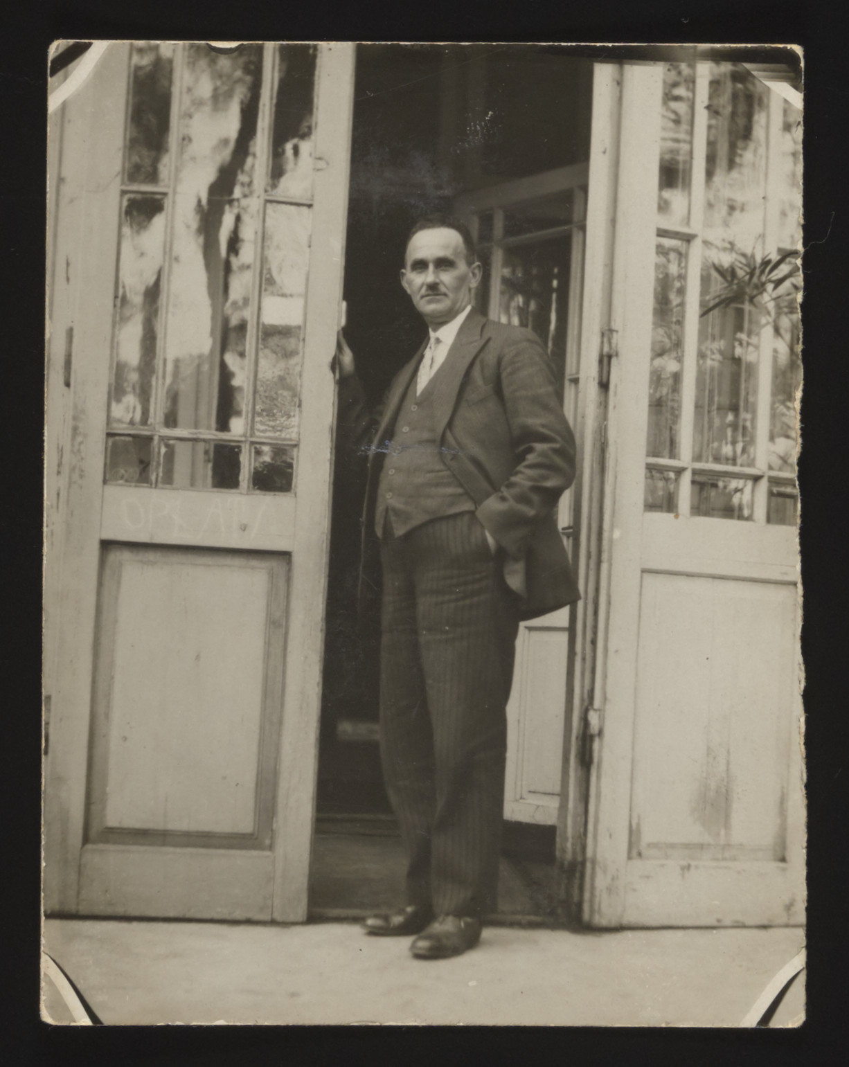 Zelig Szabason stands in the entryway to a TB sanatorium where he was staying.