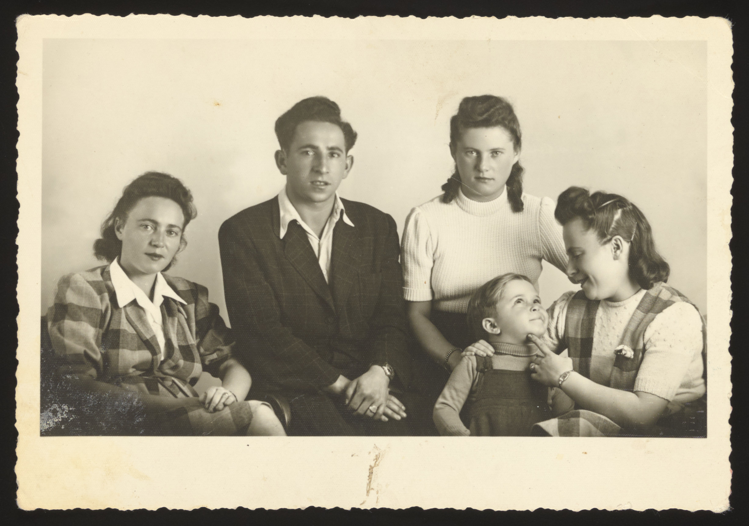 Group portrait of a Jewish family living in Munich after the war.  Pictured are (from left) Lifcia Najman, David Birenbaum (Lifcia's cousin), Gitl Najman Wolke (Lifcia's sister), Charles Silver (Lifcia's nephew), Etel Najman Silver (Lifcia's sister).