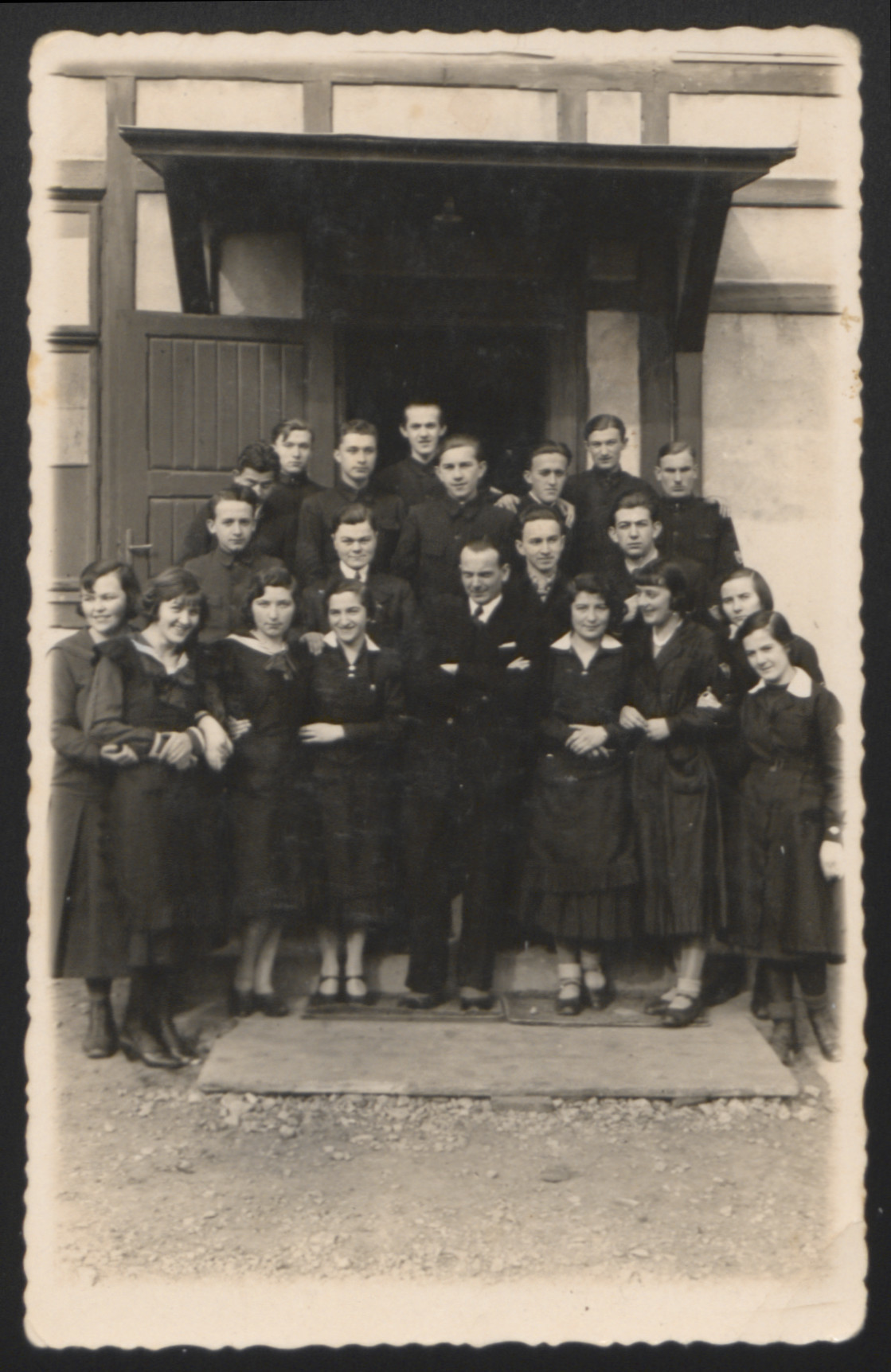 Group portrait of students and their teacher in a high school in Boryslaw.   Pictured fourth from the left is Sydzia Pomeranz, the donor's mother.