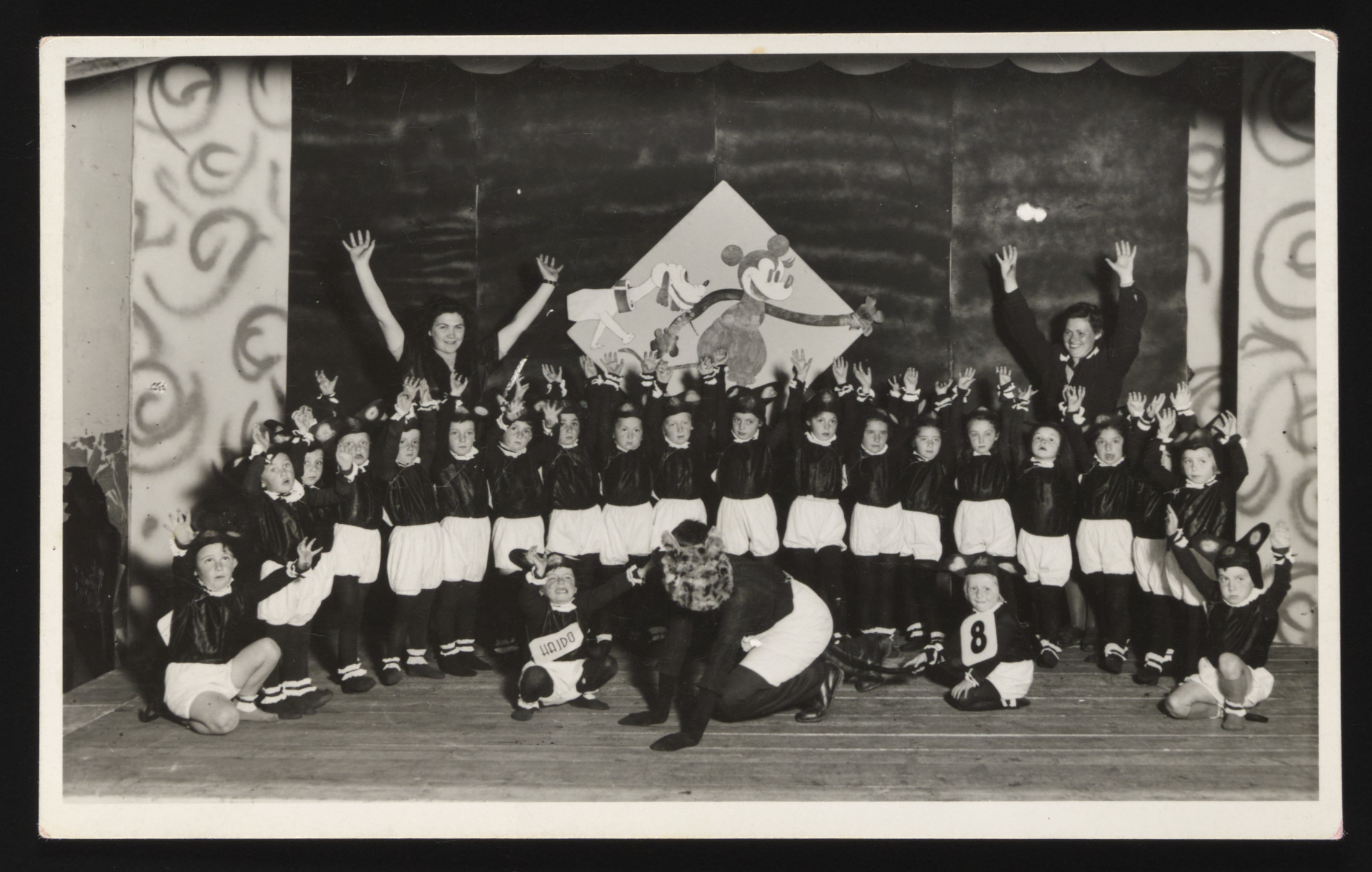 Children dressed as mice put on a school performance at the Novaky labor camp.  Among those pictured, in the second row, sixth from the right, is Mira Frenkel (now Frenkel).