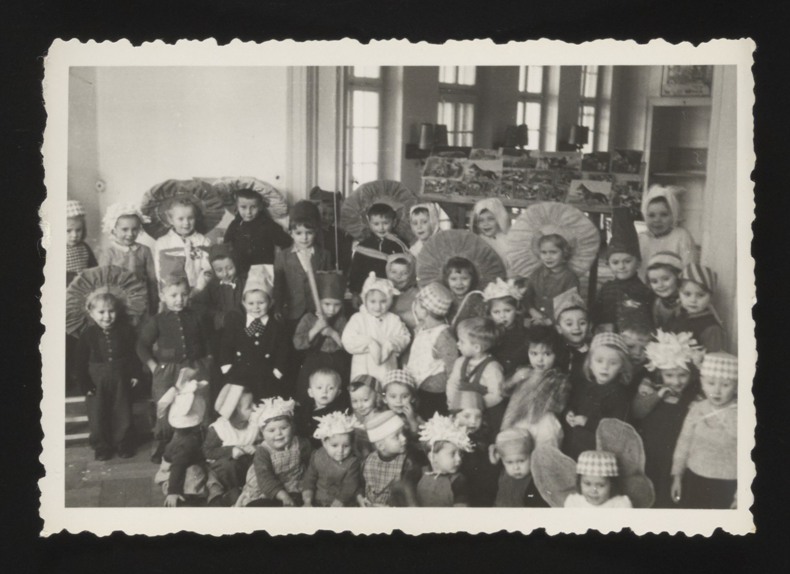 Group portrait of young children dressed in costumes [probably for a Purim celebration in the Deggendorf] displaced persons camp,