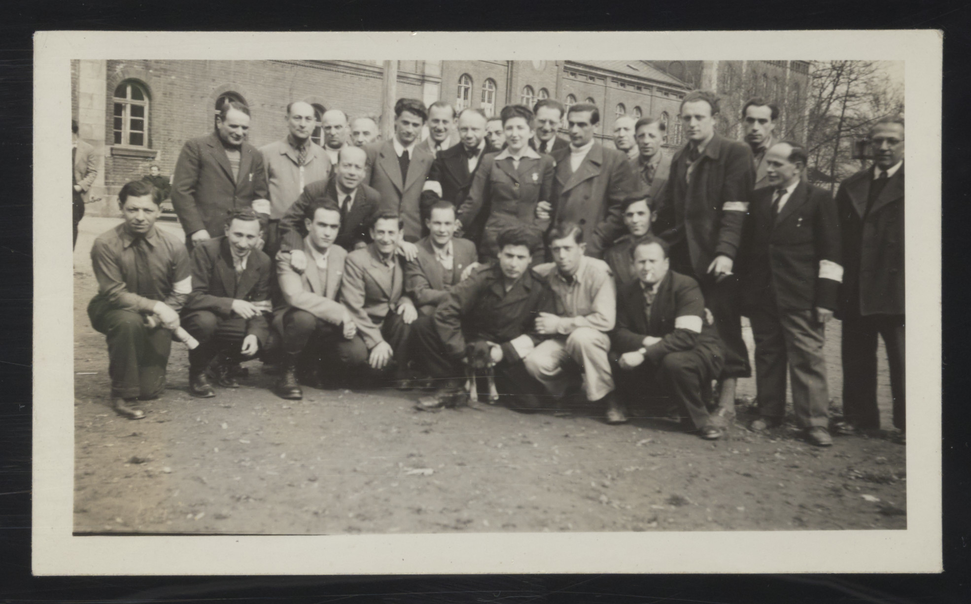 Group portrait of Jewish men wearing armbands in the Deggendorf displaced persons camp.