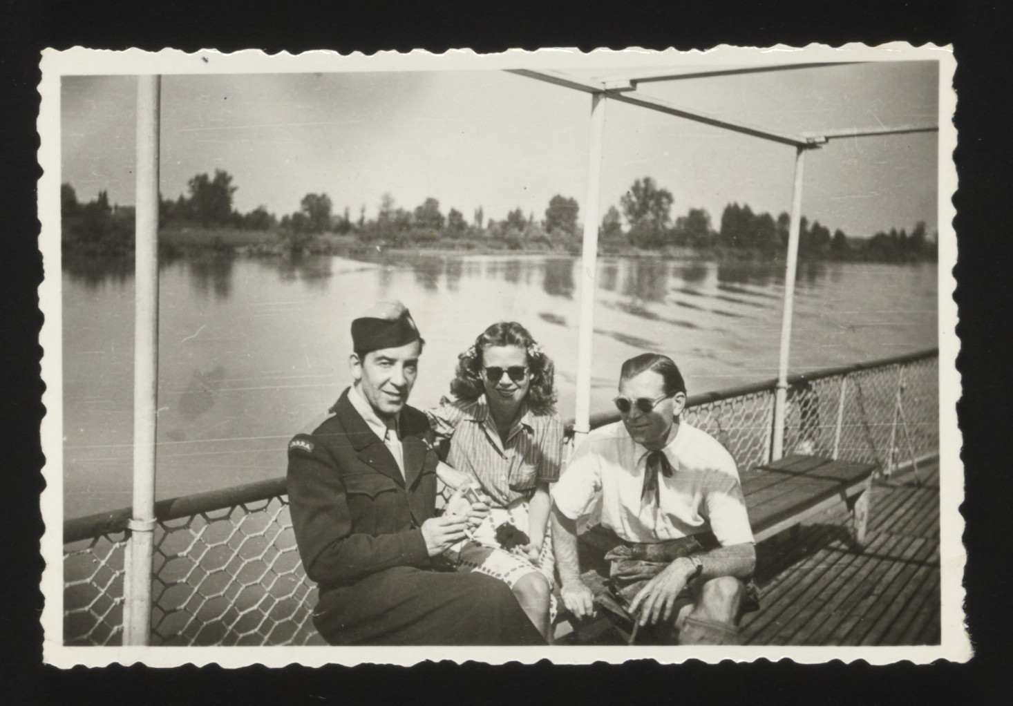 UNRRA officer, William Buckhantz poses with two friends by the shore of the Danube near the Deggendorf displaced persons camp.