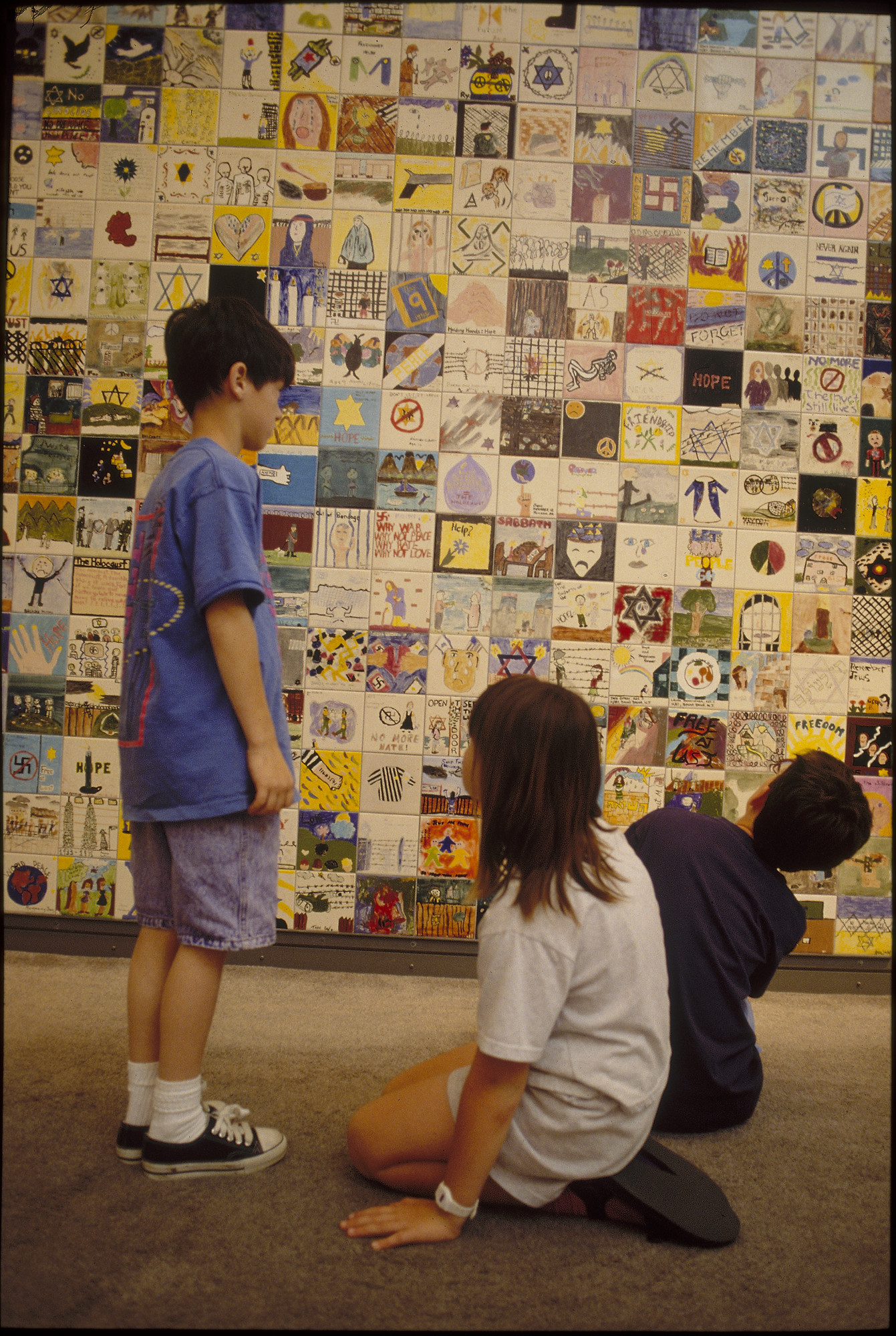 Children view the Tile Wall on the concourse of the U.S. Holocaust Memorial Museum.
