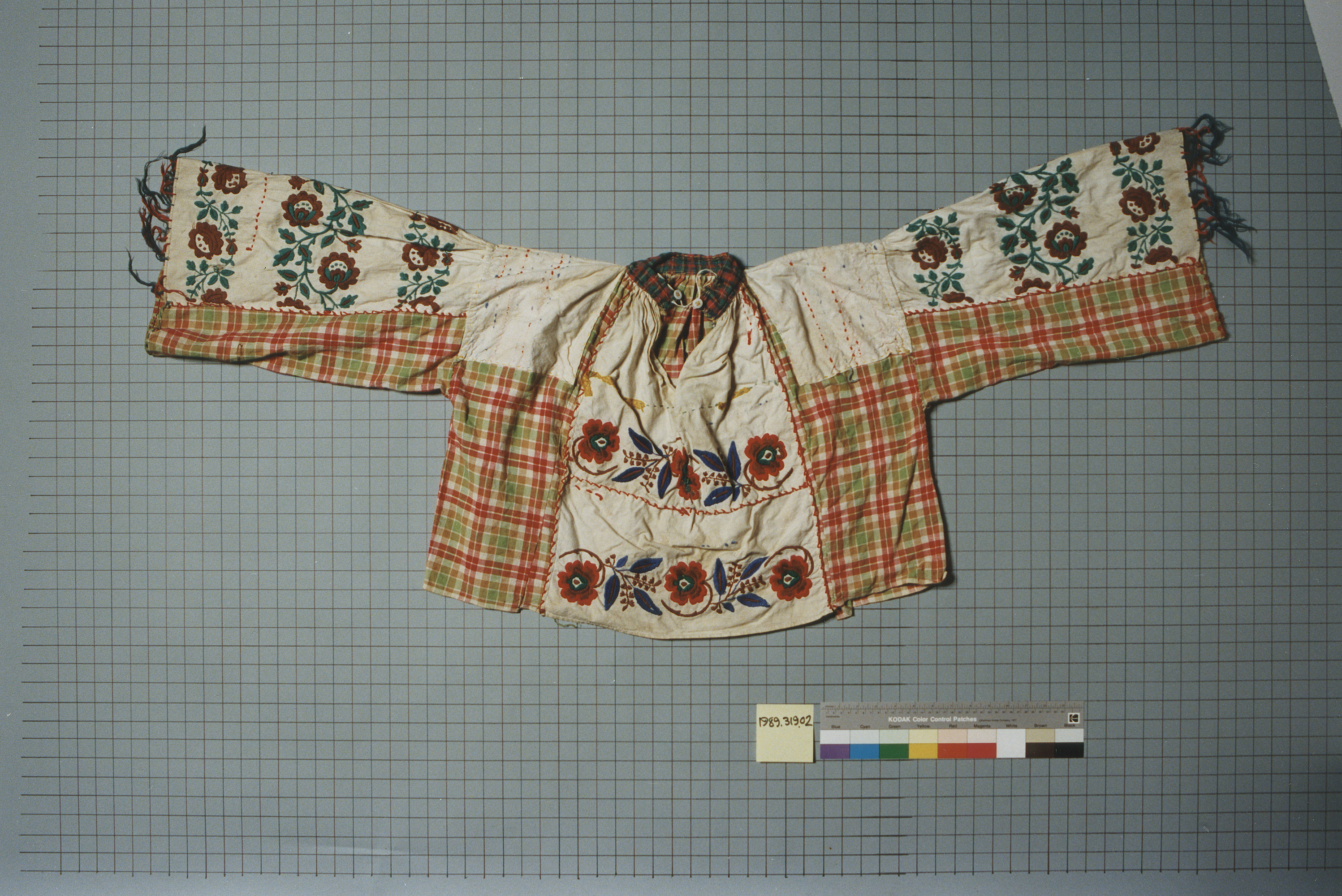 Embroidered shirt worn for special occasions by the donor's father, Gheorge Cioaba, chief of the Calderai, a Romanian Gypsy tribe. The shirt was in his possession during the period 1942-1945.