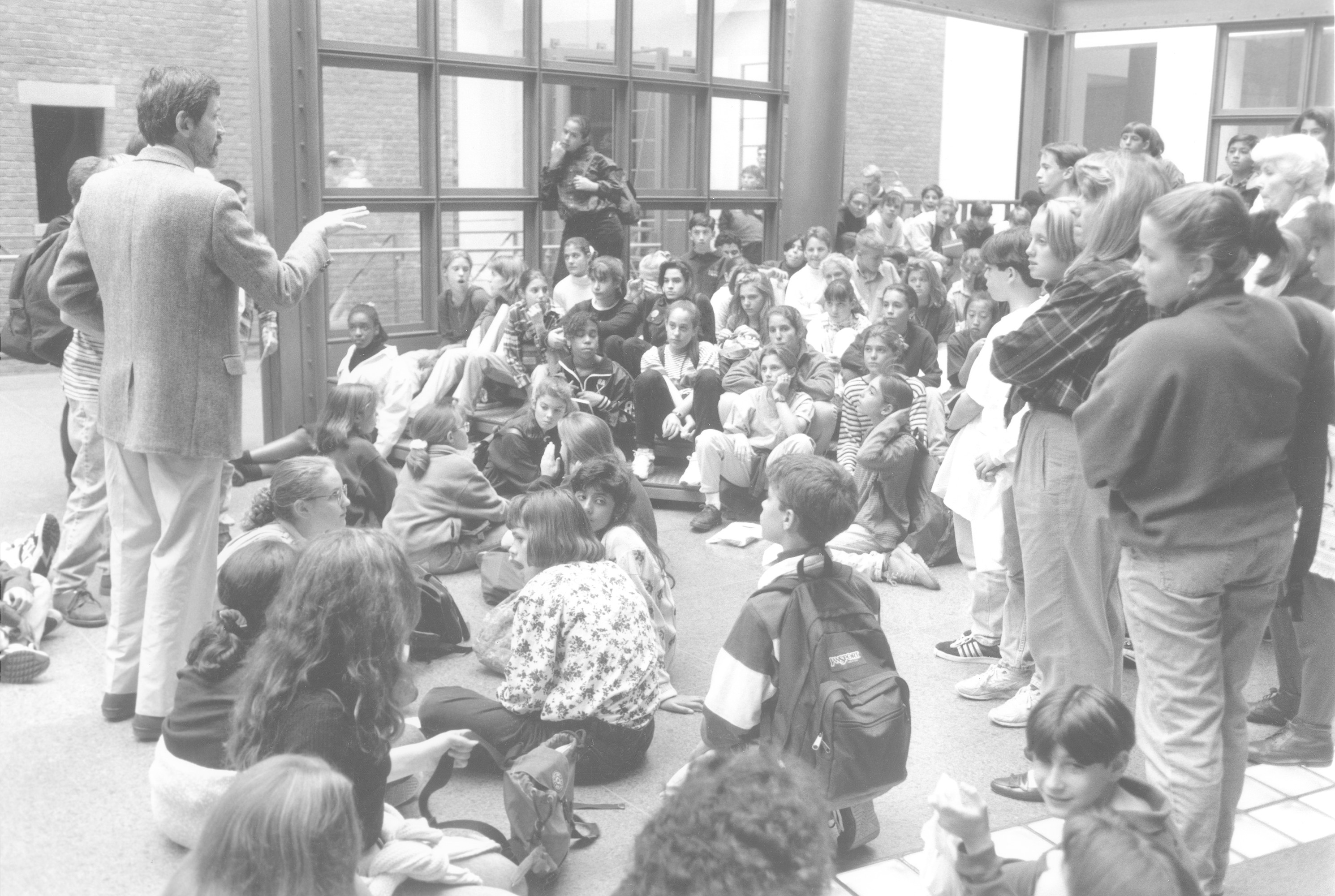 A teacher lectures to a visiting school group in the Hall of Witness at the U.S. Holocaust Memorial Museum.