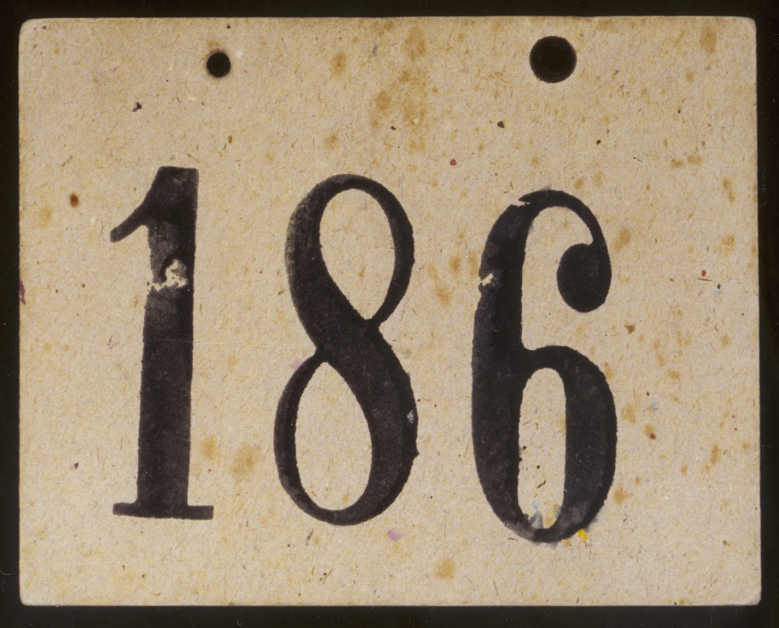 Numbered identification tag worn by Henry Schmelzer when he was a member of a Kindertransport sent from Austria to England in December 1938.