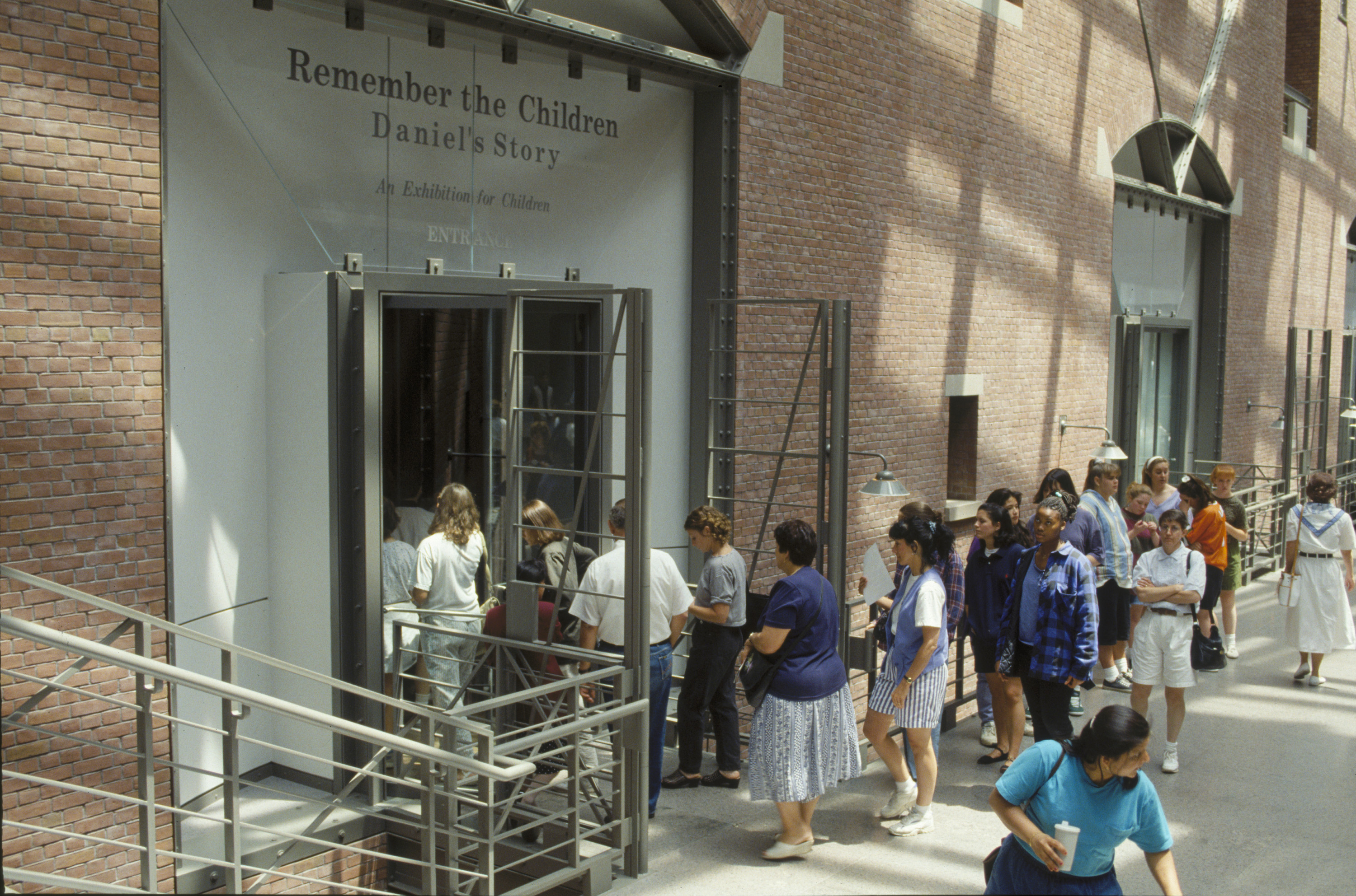 """Visitors enter the special exhibition """"Daniel's Story: Remember the Children"""" from the Hall of Witness in the U.S. Holocaust Memorial Museum."""