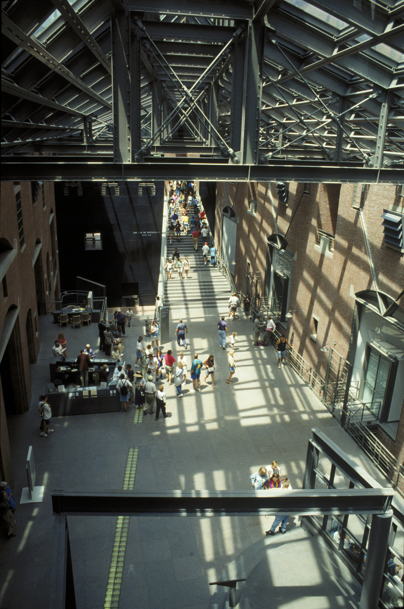 Visitors in the Hall of Witness in the U.S. Holocaust Memorial Museum taken from the second floor.