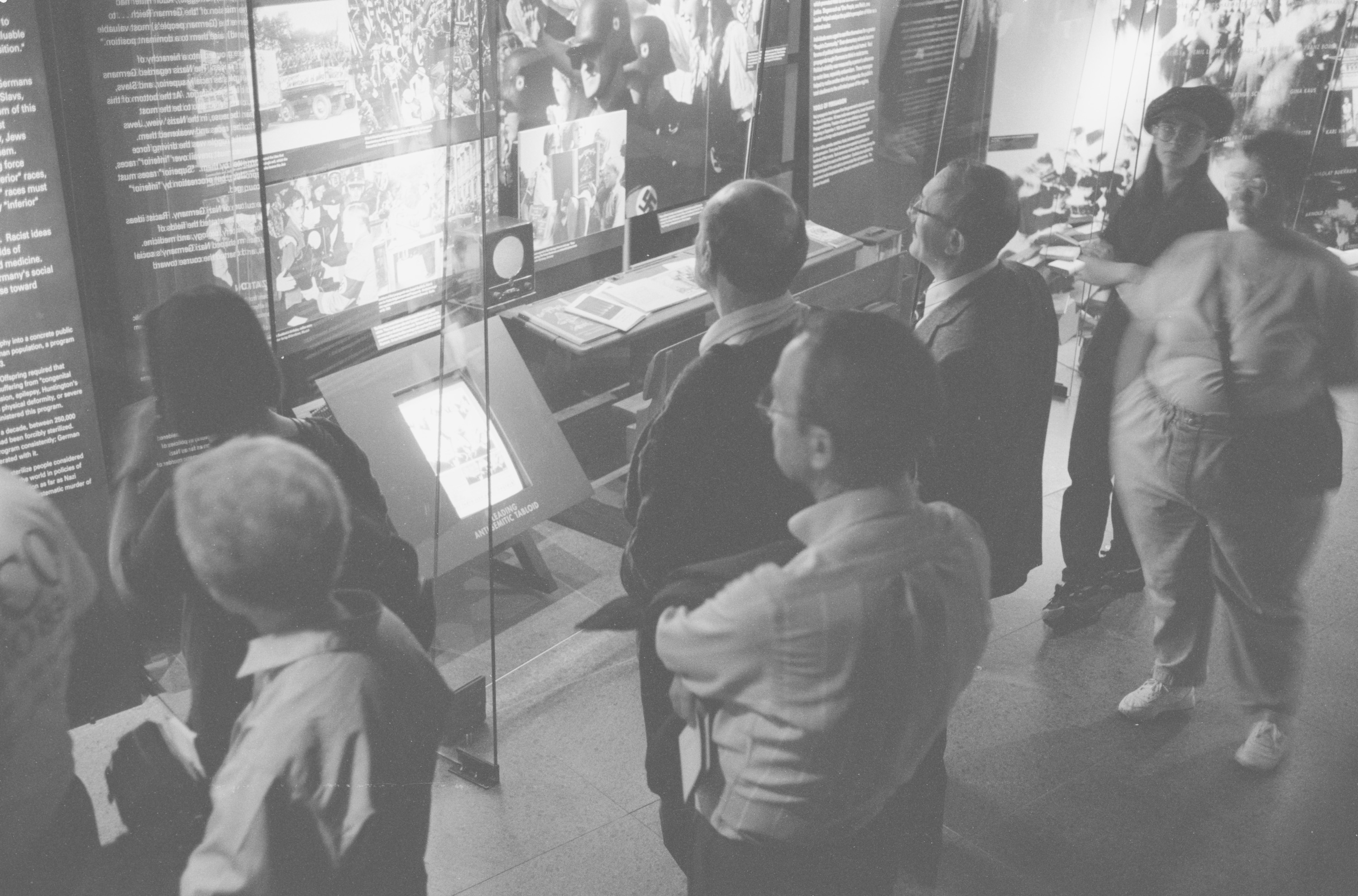 Visitors on the fourth floor of the permanent exhibition at the U.S. Holocaust Memorial Museum.