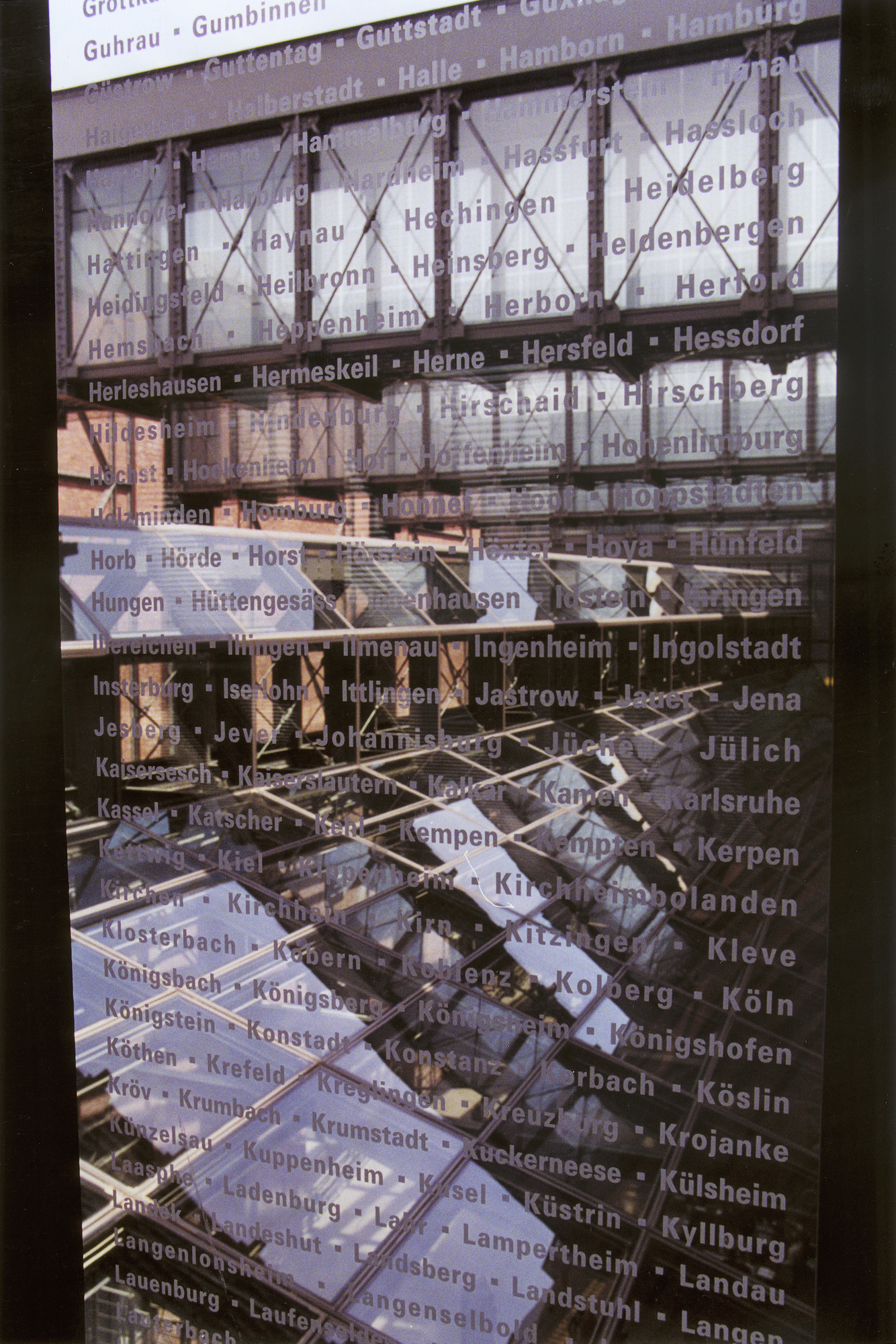 Interior of one of the glass bridges in the permanent exhibition of the U.S. Holocaust Memorial Museum, etched with the names of communities that were destroyed during the Holocaust.