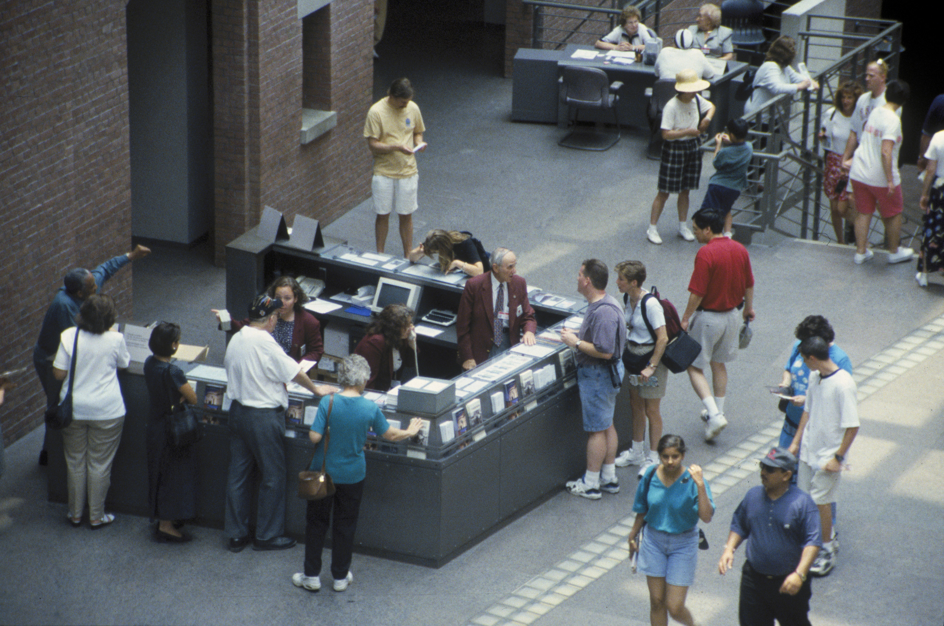 Visitors at the information desk in the Hall of Witness at the U.S. Holocaust Memorial Museum.