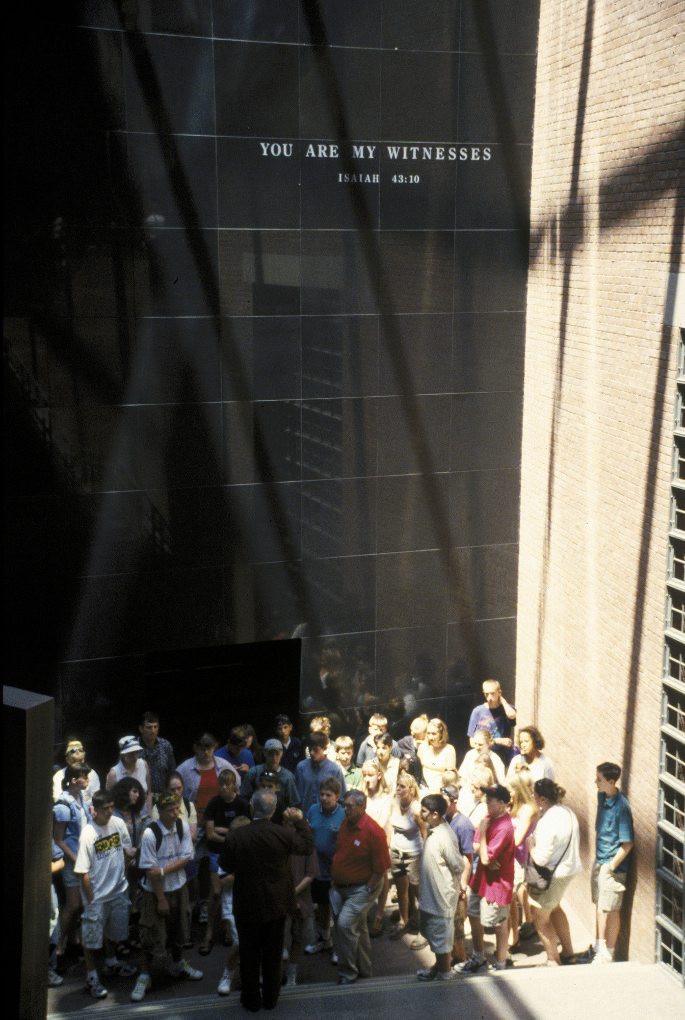 A group of visitors in the Hall of Witness at the U.S. Holocaust Memorial Museum.