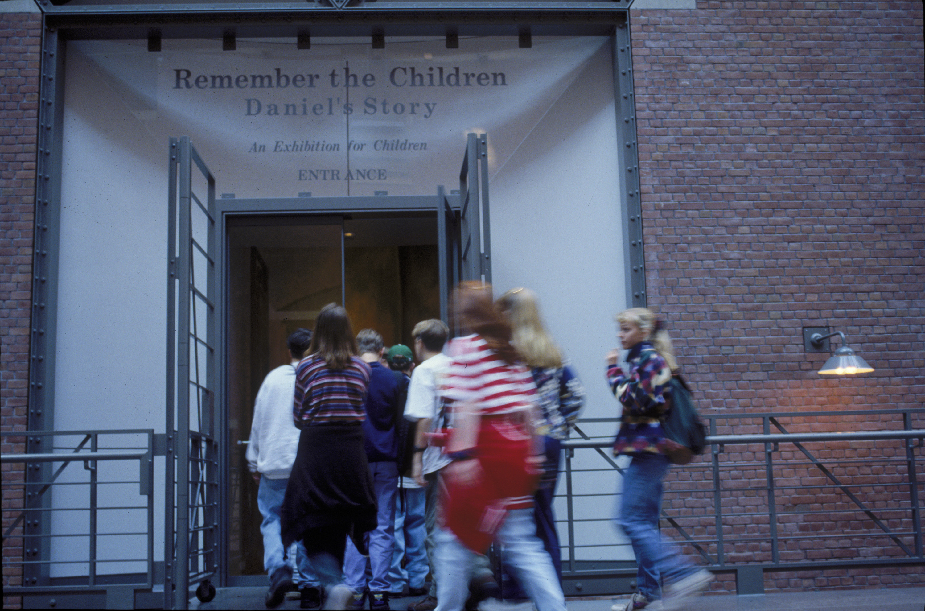 A group of children enter the Remember the Children: Daniel's Story exhibit in the Hall of Witness at the U.S. Holocaust Memorial Museum.