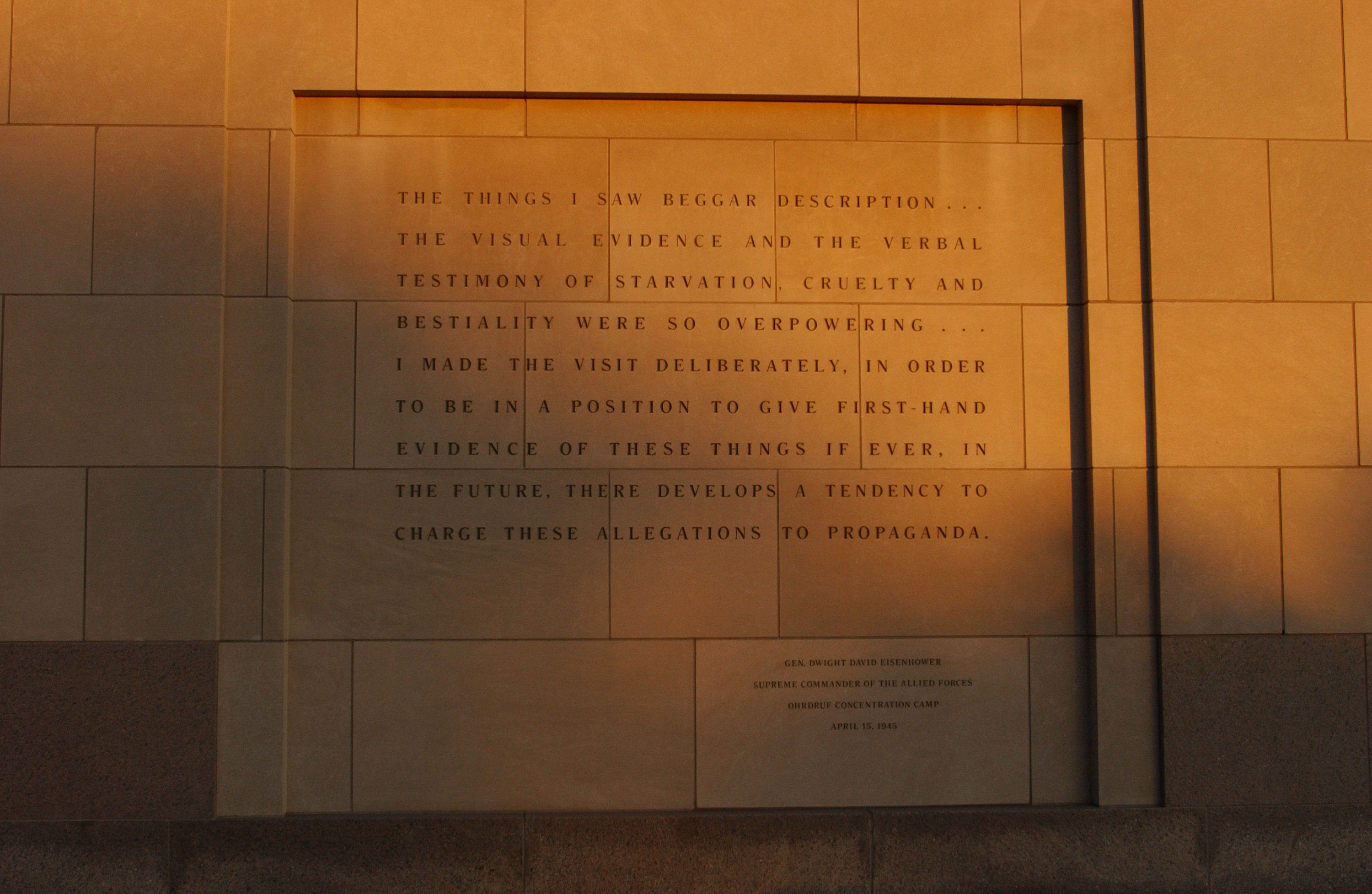 The quotation by Gen. Dwight David Eisenhower on the exterior of the Hall of Remembrance facing Eisenhower Plaza,  the U.S. Holocaust Memorial Museum.