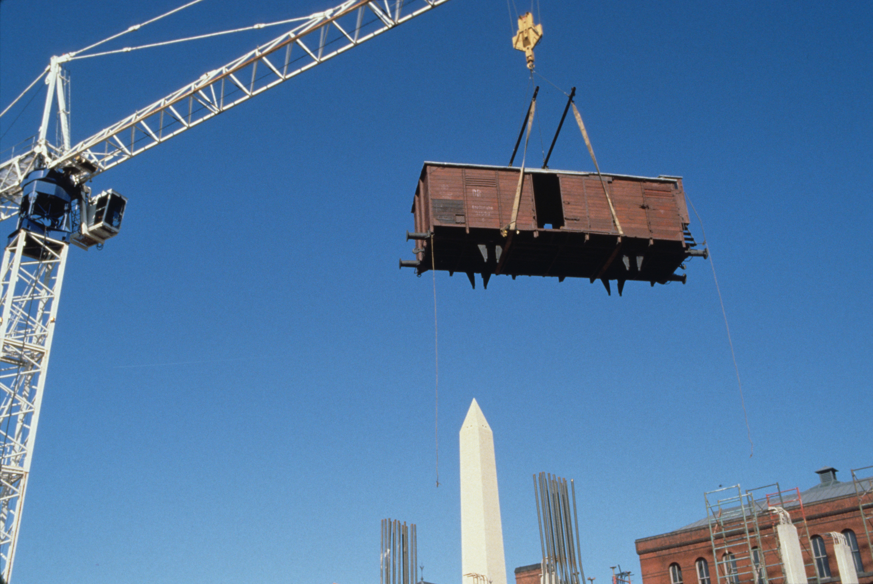 Installation of the railcar at the construction site of the U.S. Holocaust Memorial Museum.