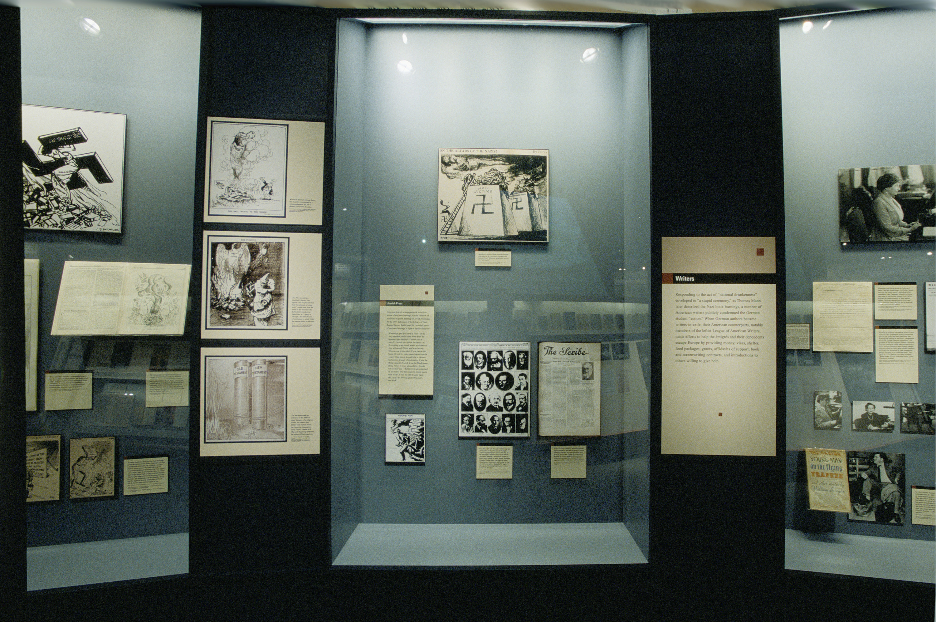 """View of a display case featuring writers in the special exhibition """"Fighting the Fires of Hate: America and the Nazi Book Burnings"""" (April 29 -- October 13, 2003), U.S. Holocaust Memorial Museum."""
