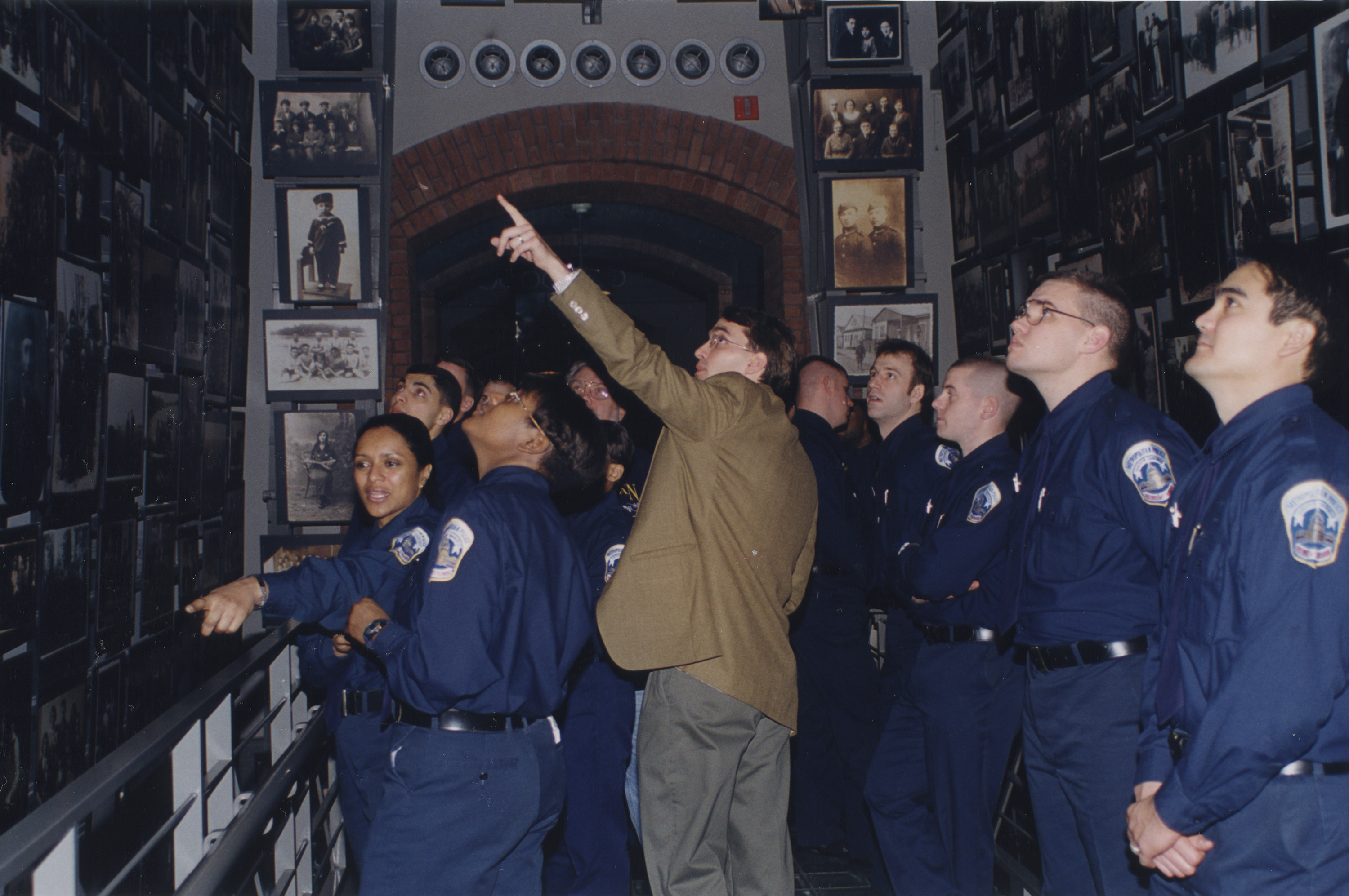 Andres Abril guides Washington, D.C. police cadets through the Tower of Faces (the Yaffa Eliach Shtetl Collection) segment of the permanent exhibition at the U.S. Holocaust Memorial Museum.