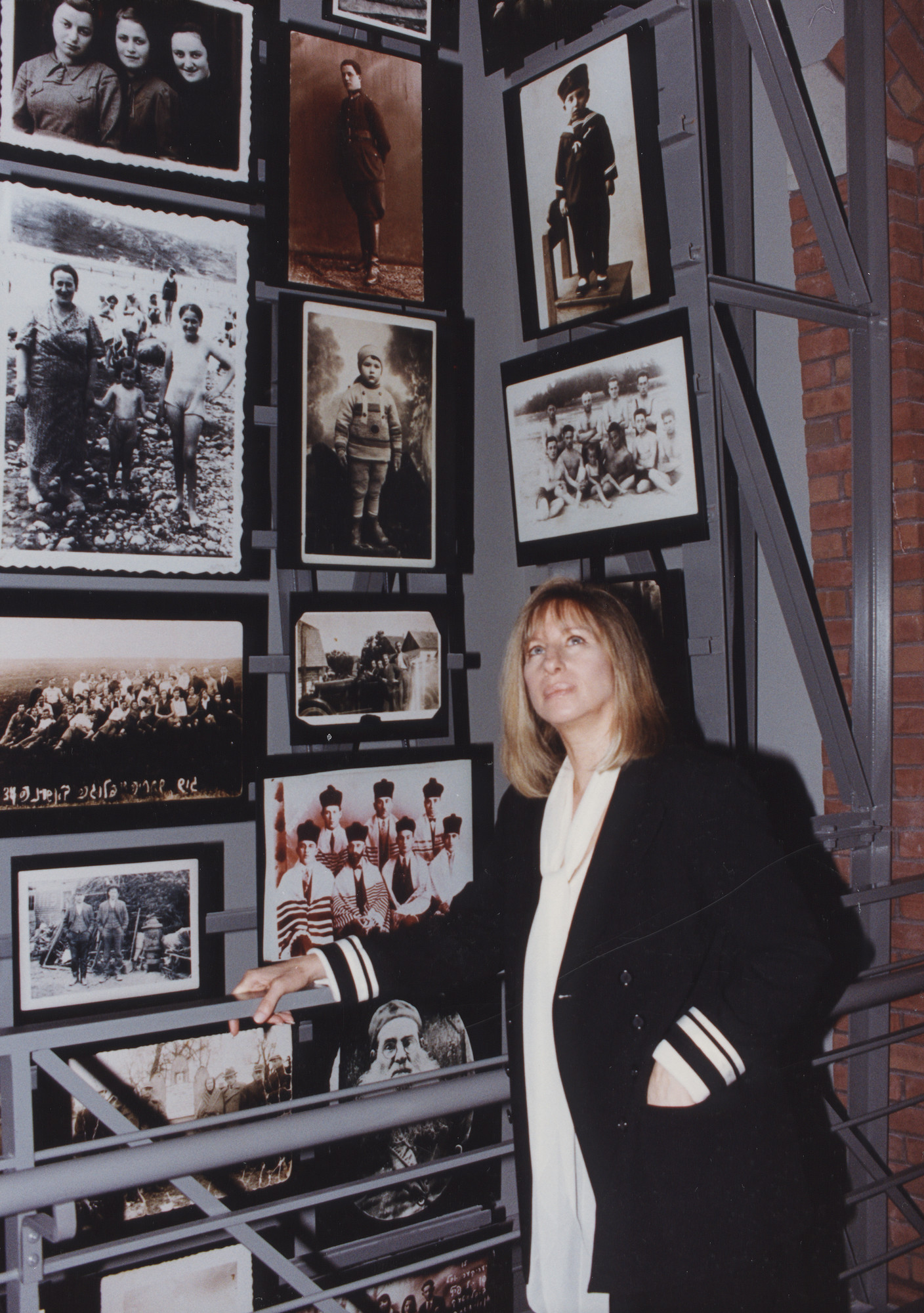 Actress Barbra Streisand poses on the bridge in the Tower of Faces (the Yaffa Eliach Shtetl Collection) segment of the Permanent Exhibition at the U.S. Holocaust Memorial Museum.