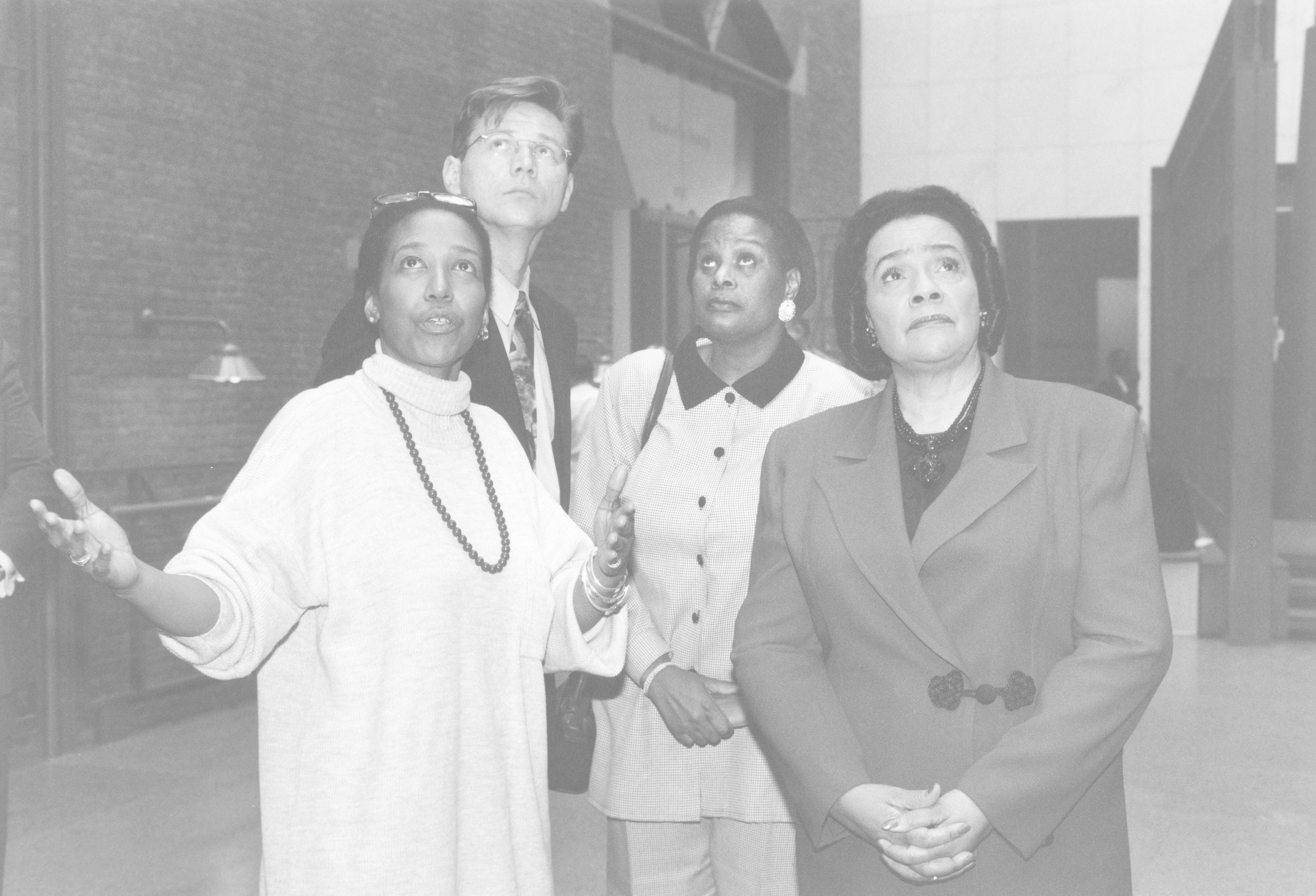 Coretta Scott King (right) views the Hall of Witness during a tour of the U.S. Holocaust Memorial Museum conducted by staff member Lynn Williams.