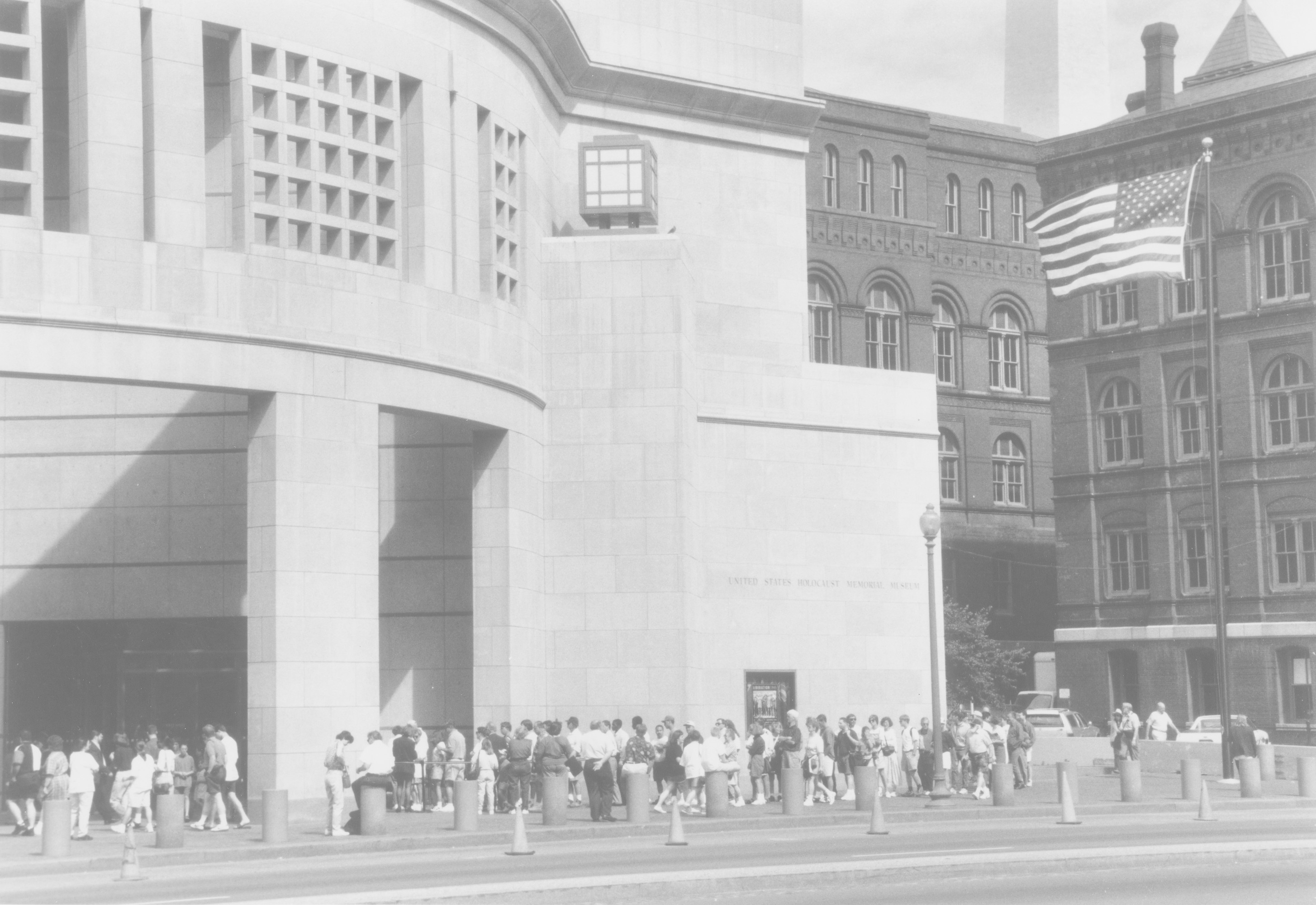 Visitors line up for tickets in front of the 14th Street entrance to the U.S. Holocaust Memorial Museum.